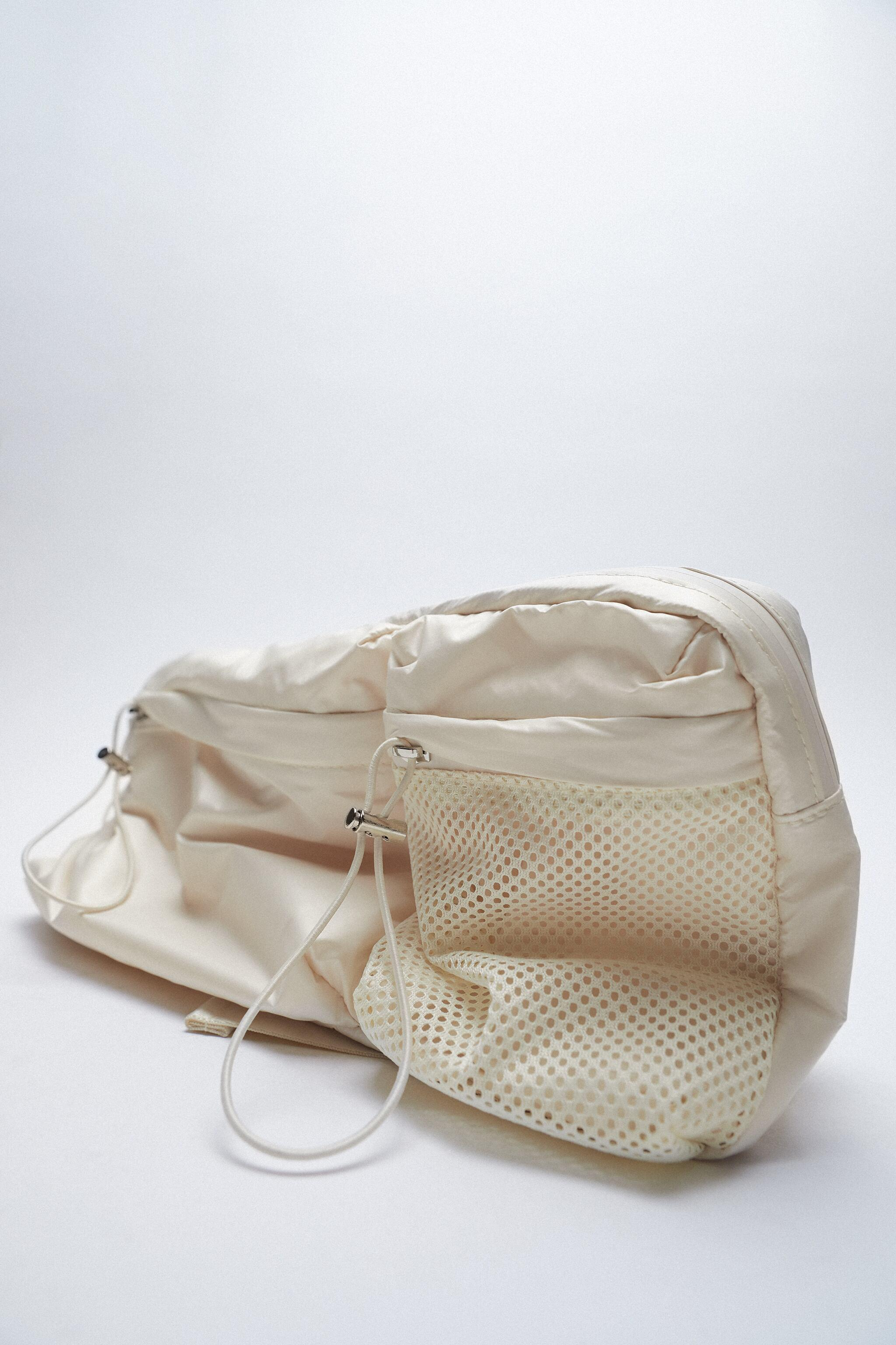 TECHNICAL FABRIC BELT BAG WITH POCKETS 1