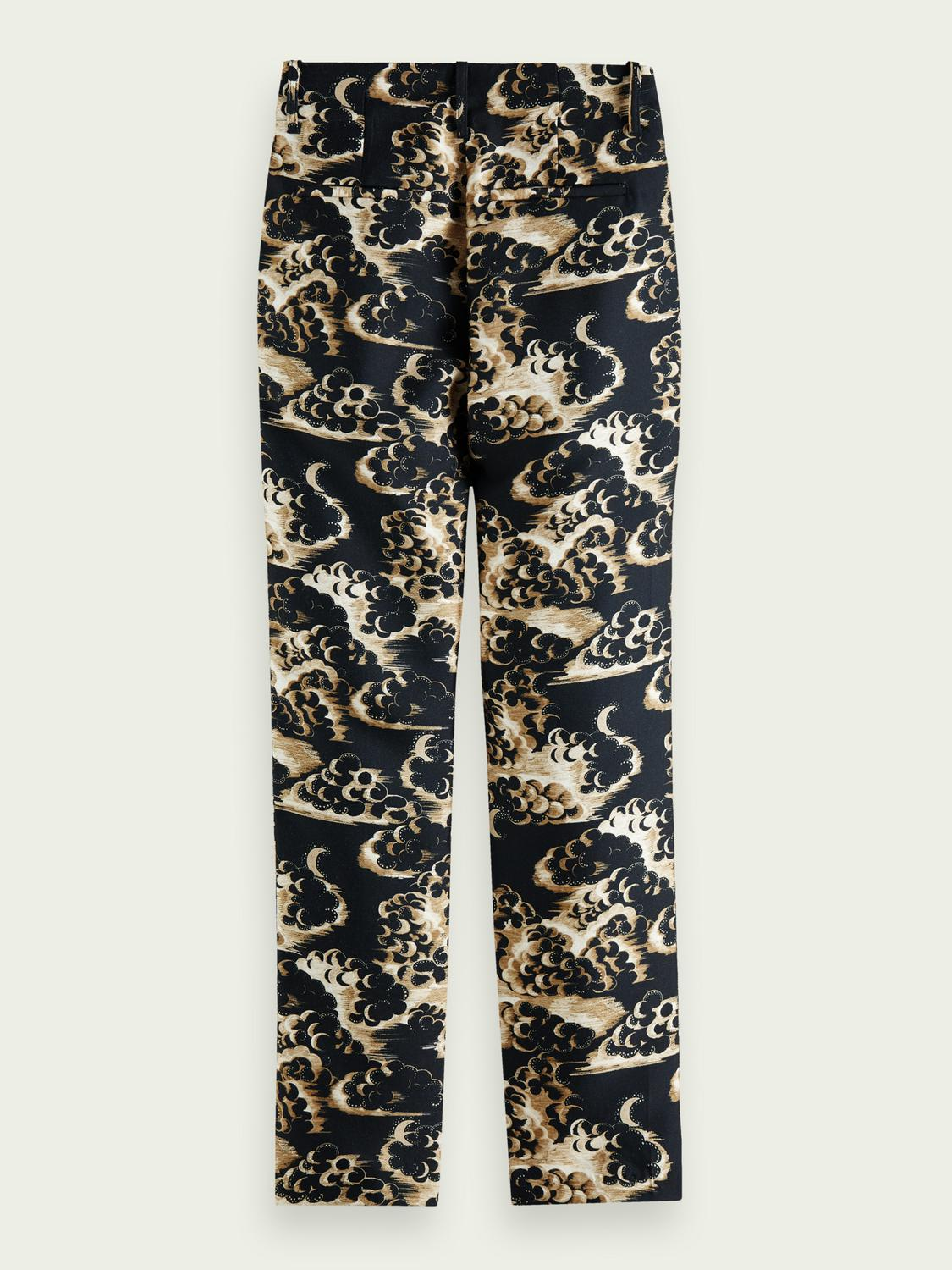 Printed tapered mid-rise trousers 7