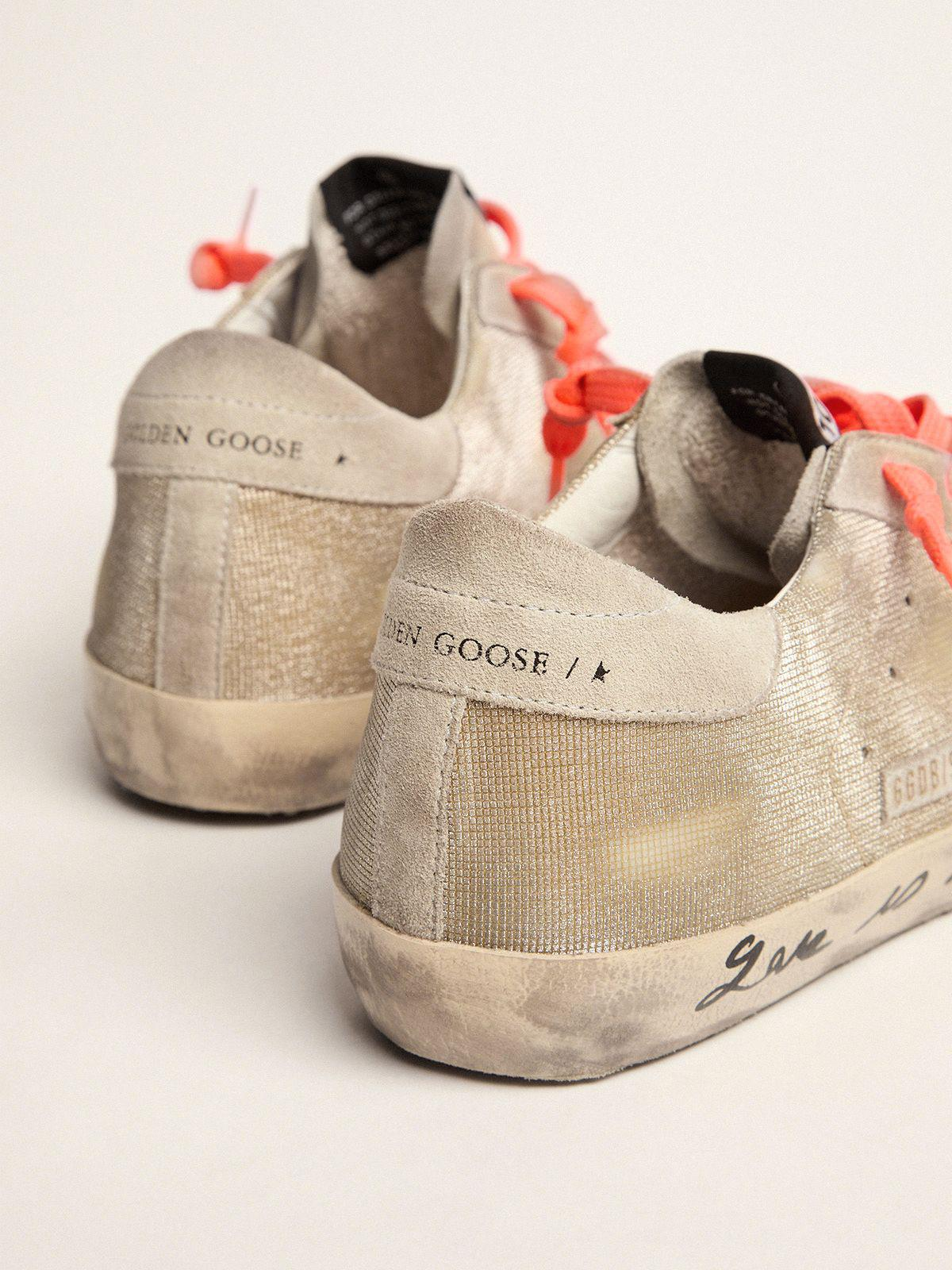 Golden Super-Star sneakers with checkered pattern and hand lettering on the foxing 4
