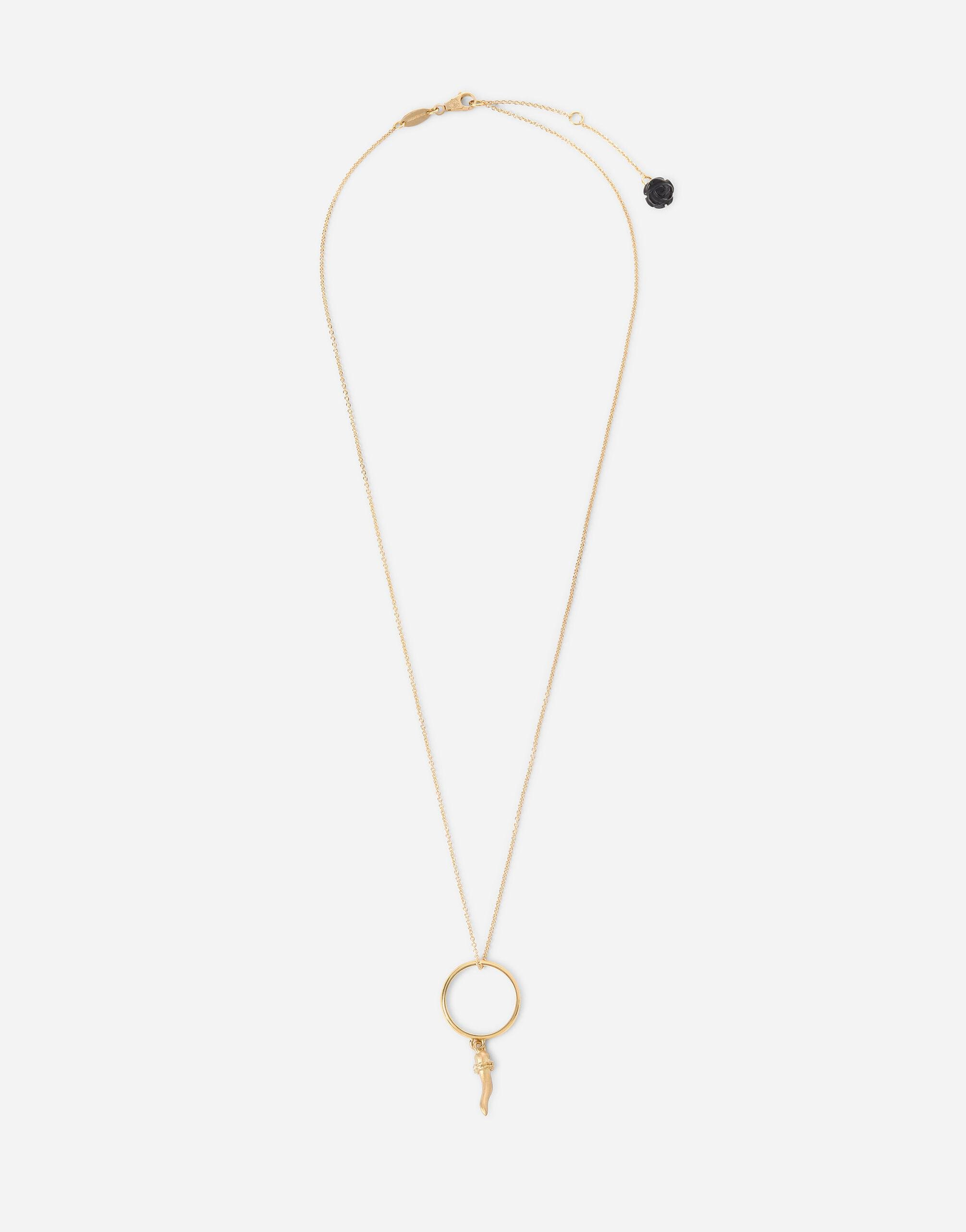 Good Luck pendant in yellow 18kt gold with ring and horn