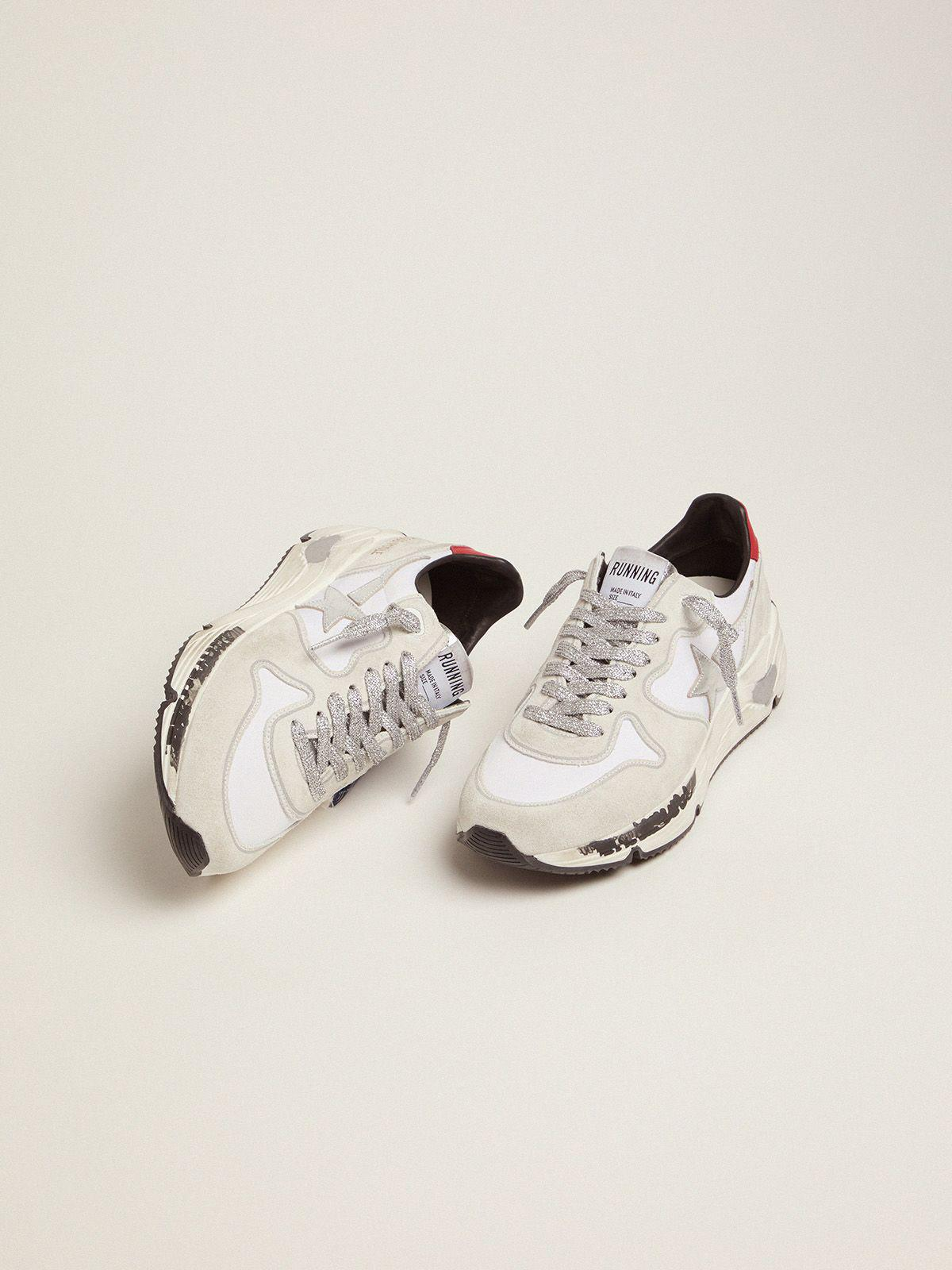 Running Sole sneakers with red heel tab and silver star 1