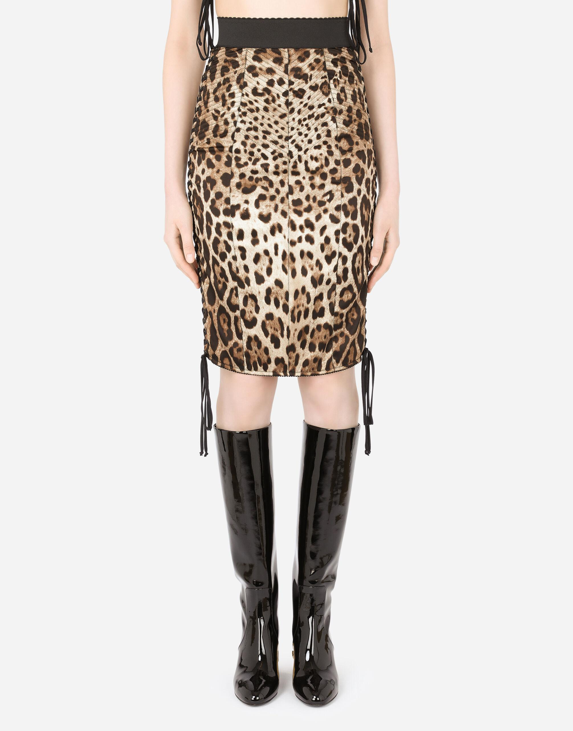 Leopard-print satin midi skirt with laces and eyelets