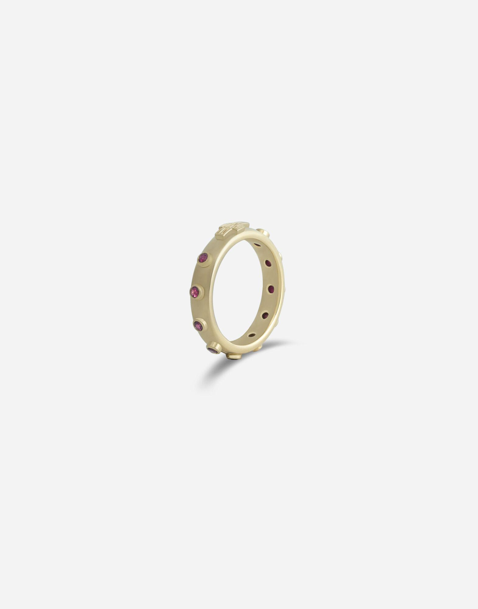Devotion band in yellow gold with rubies 1