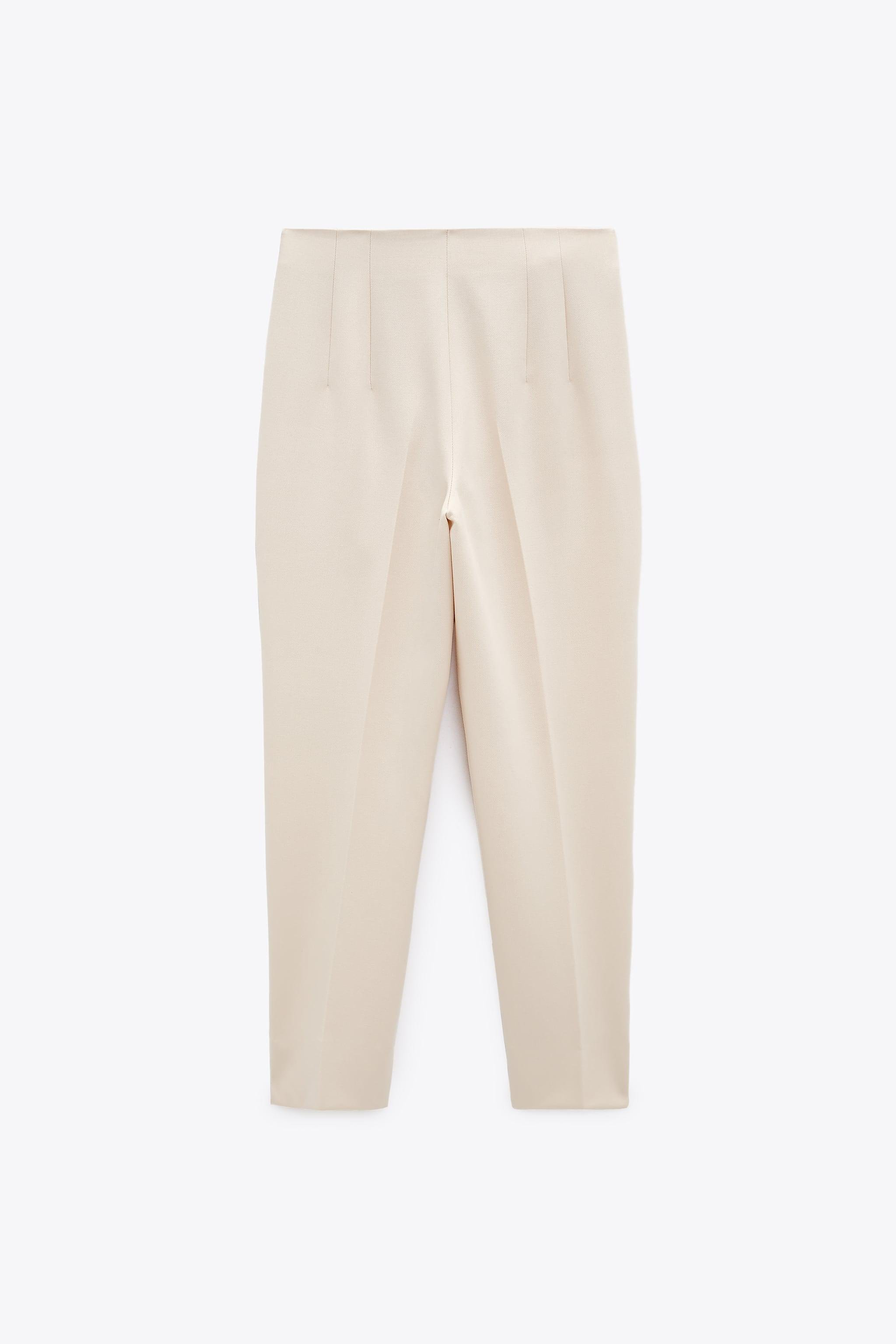 HIGH-WAISTED PANTS WITH VENTS 9