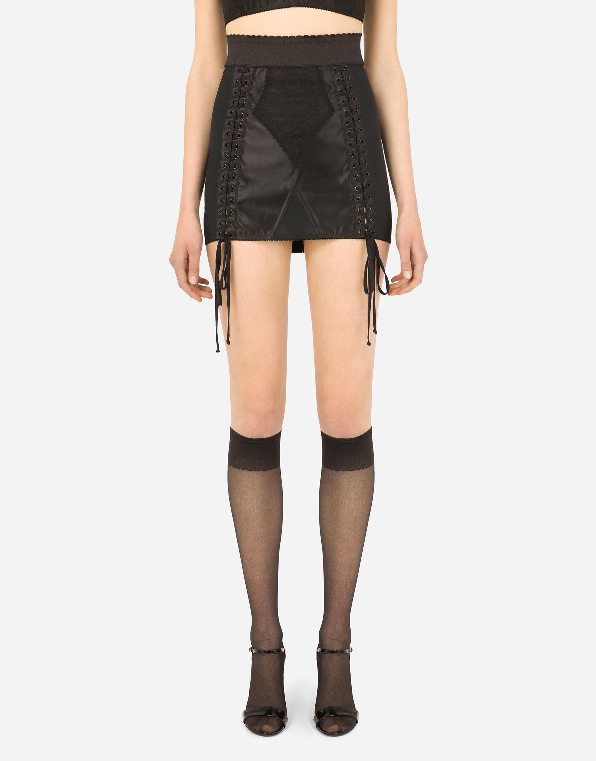 Corset-style miniskirt with laces and eyelets