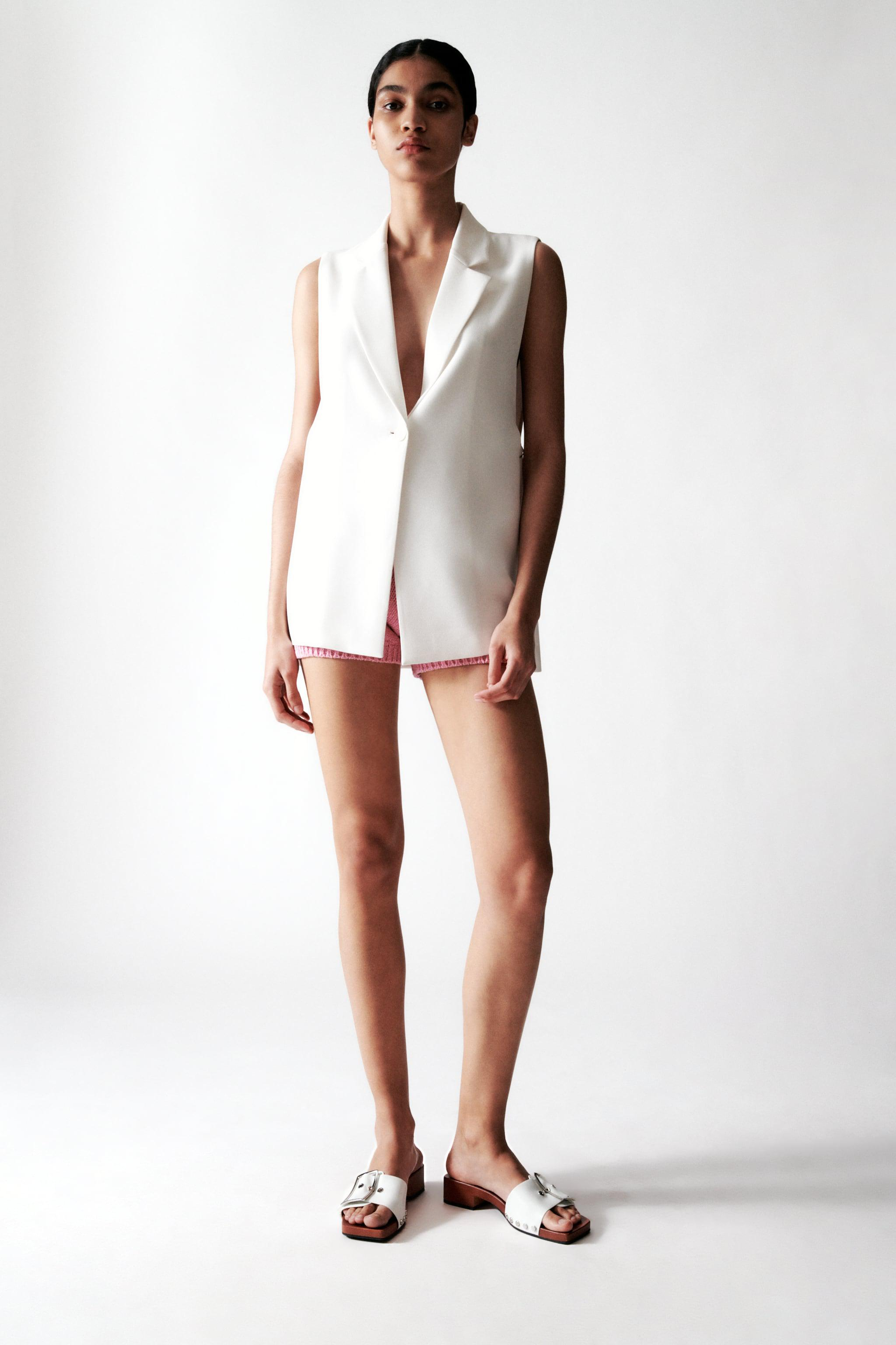 VEST WITH SLITS