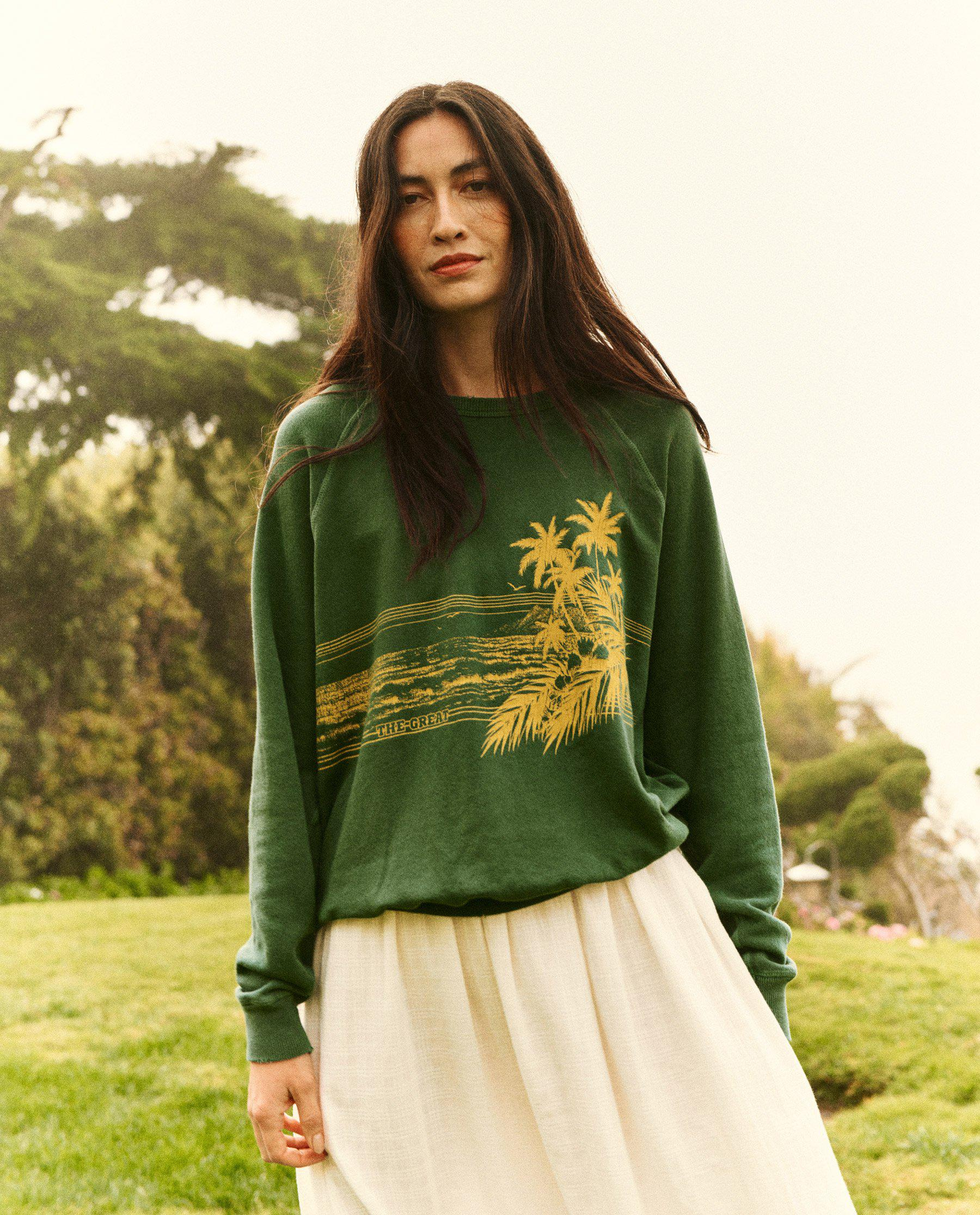 The College Sweatshirt. Graphic -- Palm Leaf with Shoreline Graphic