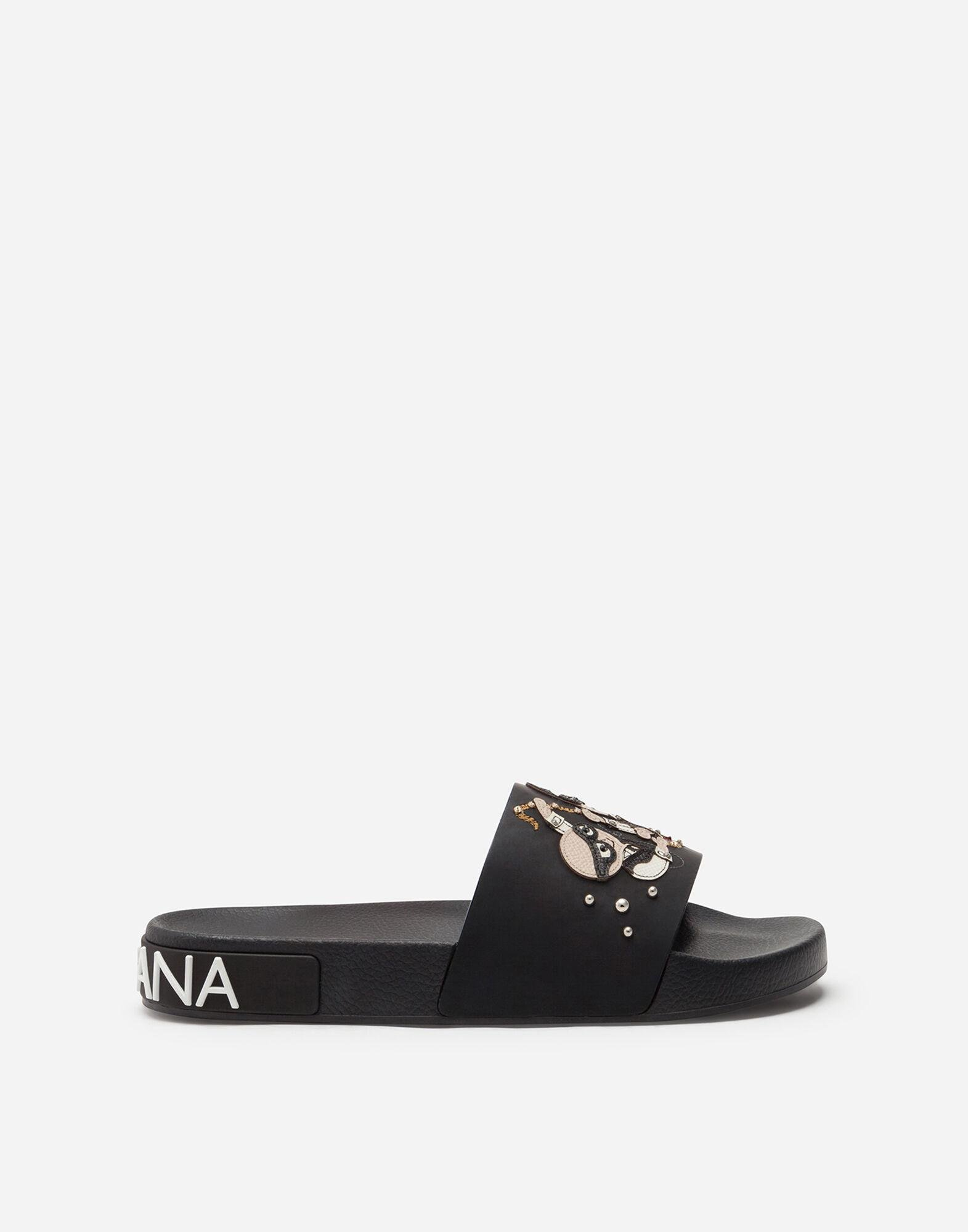 Rubber beachwear sliders with stylist patches