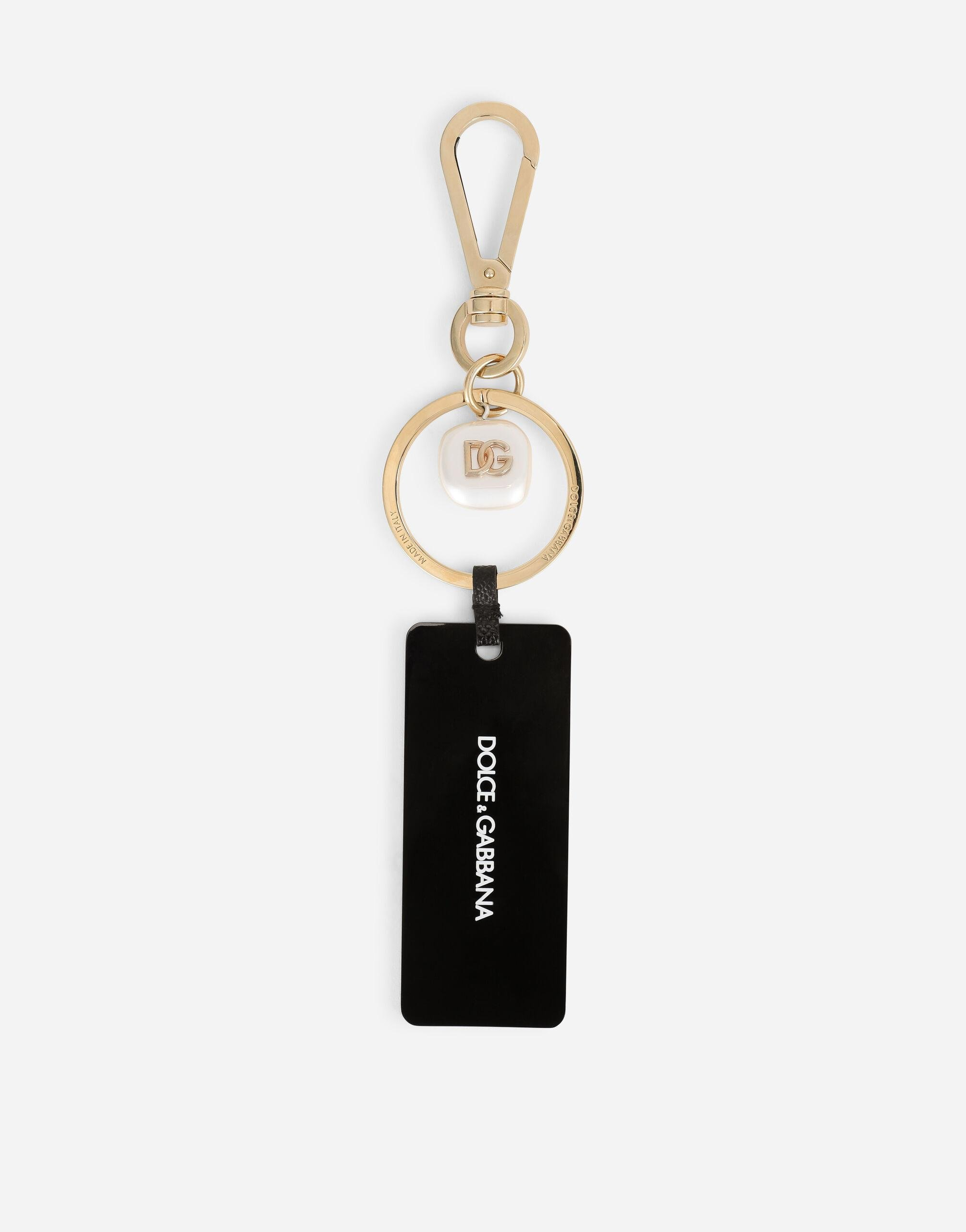 Metal keychain with tag and branded pearl