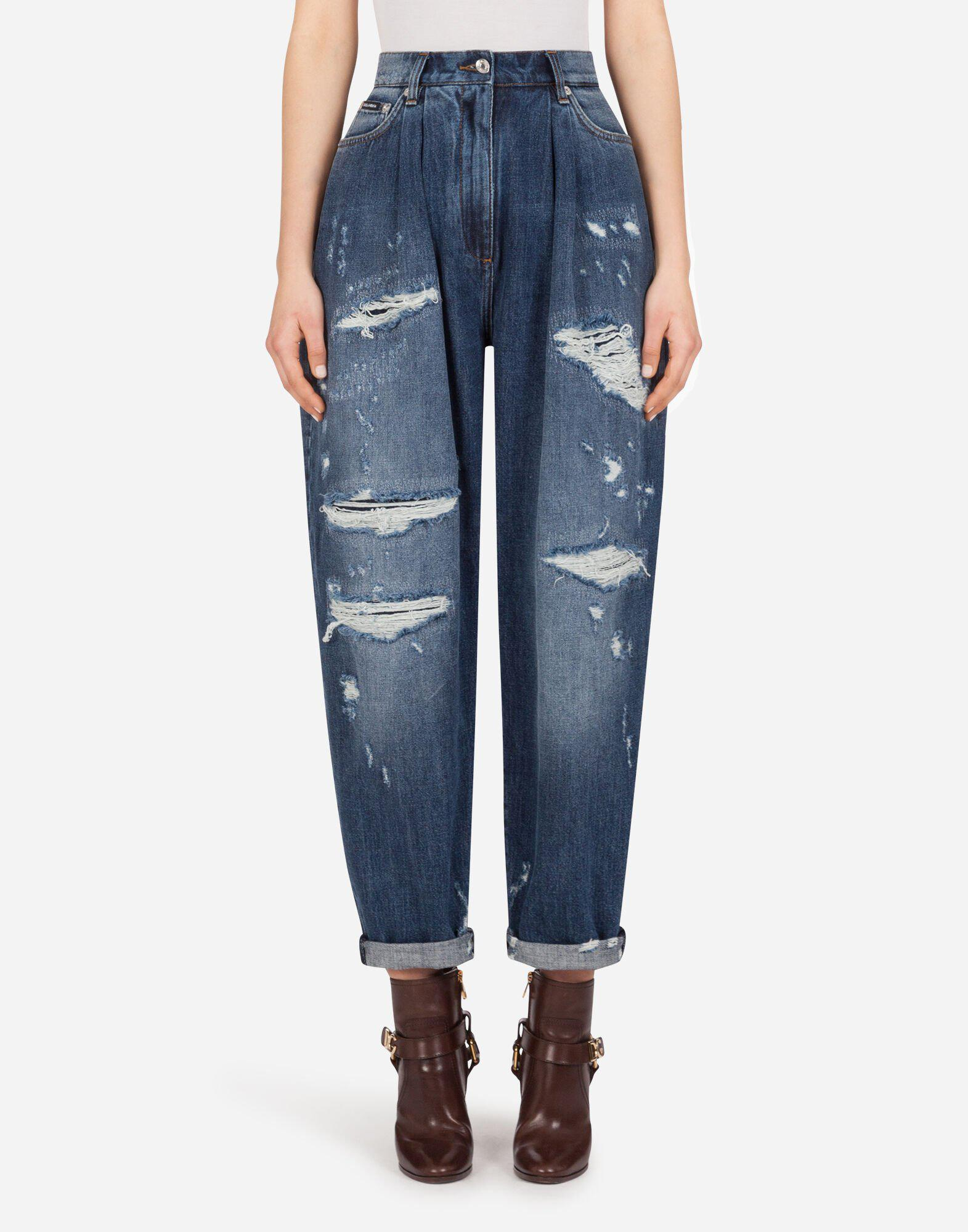 Balloon jeans in deep blue denim with rips