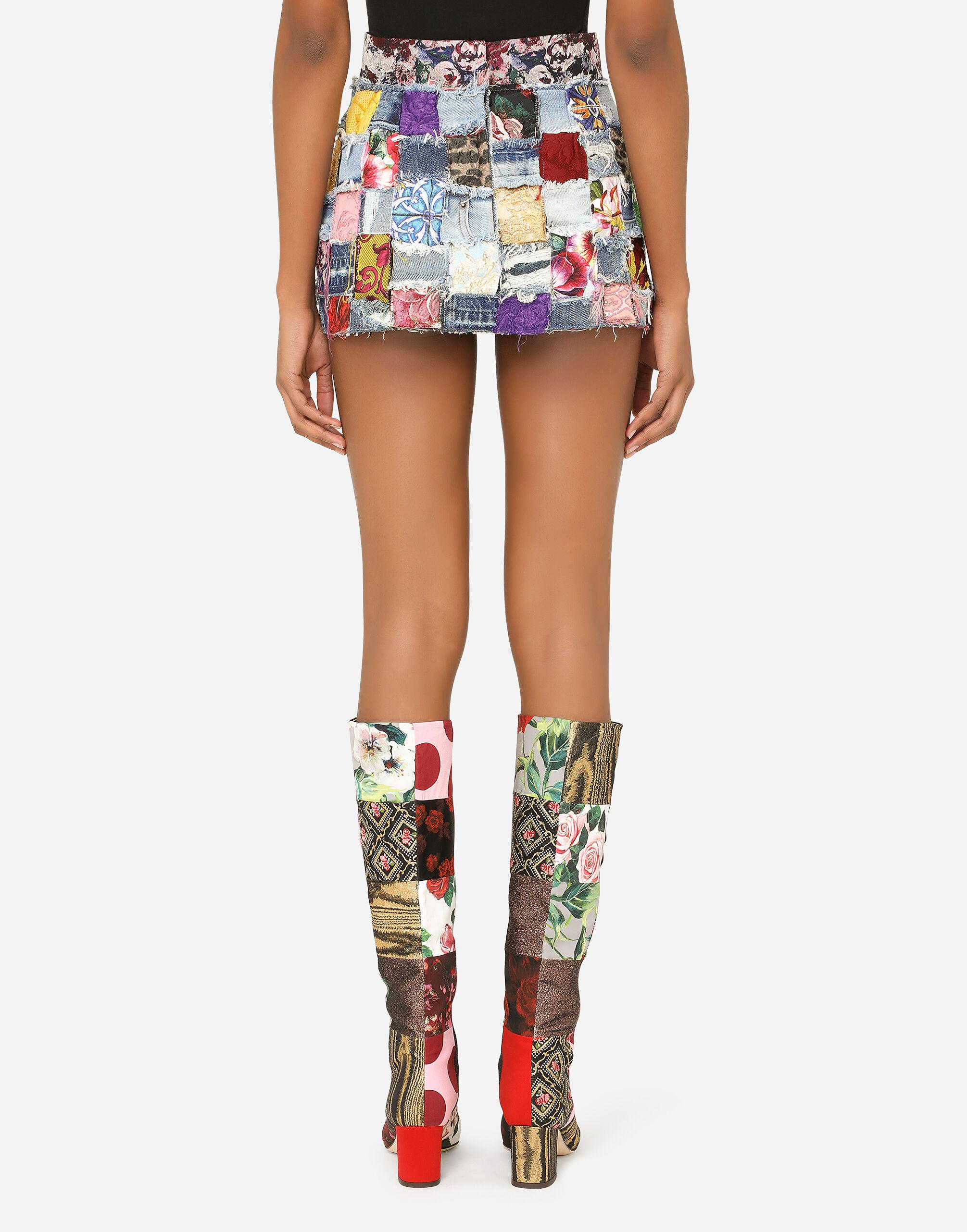 Denim miniskirt with interwoven patchwork detailing and bejeweled buttons 1