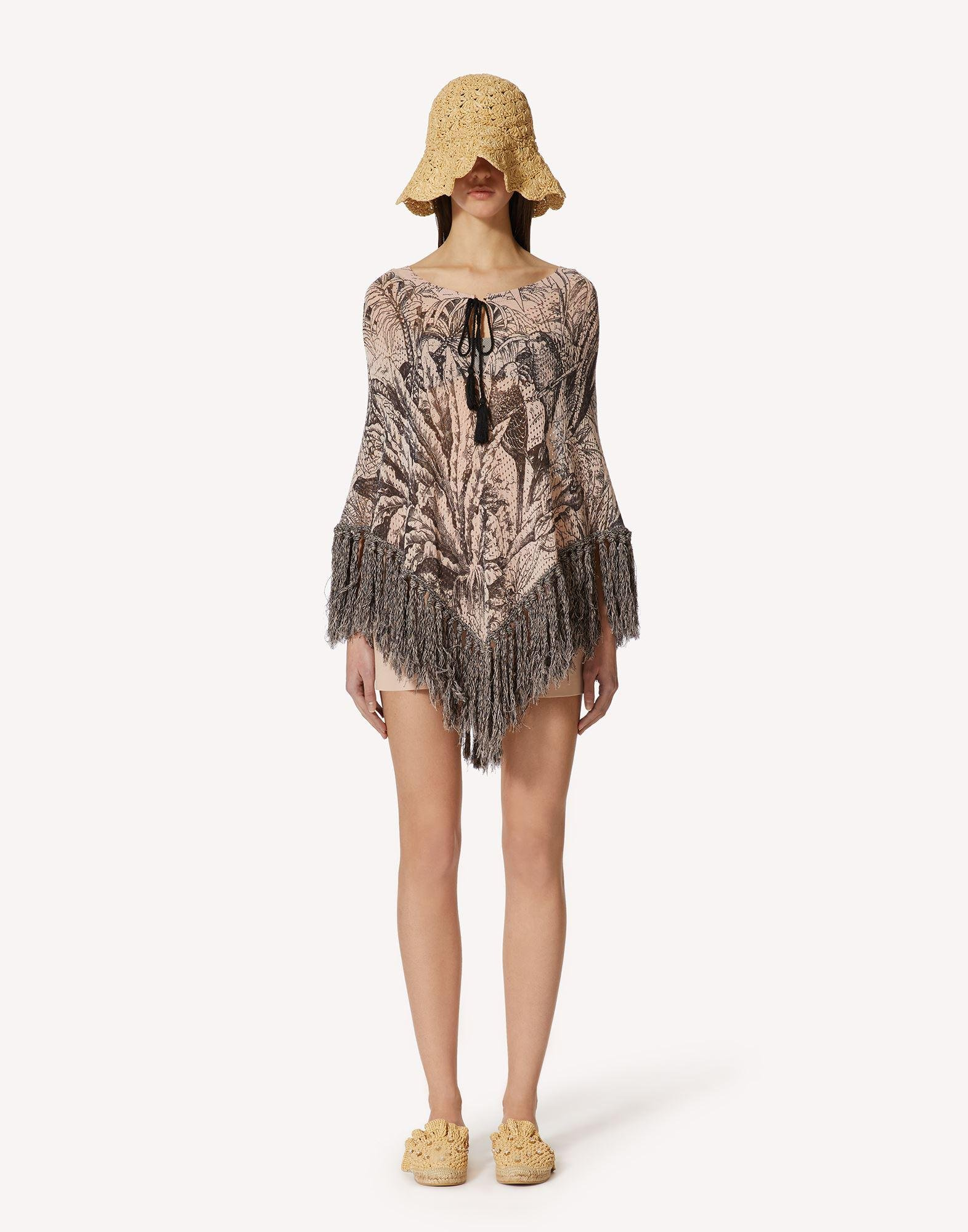 KNIT PONCHO WITH JUNGLE TOILE PRINT
