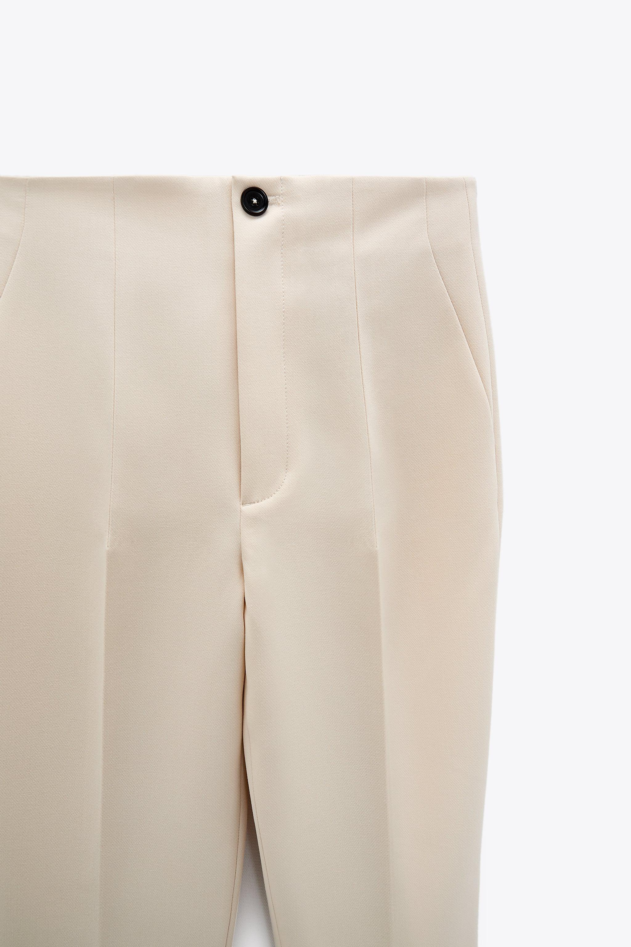 HIGH-WAISTED PANTS WITH VENTS 10