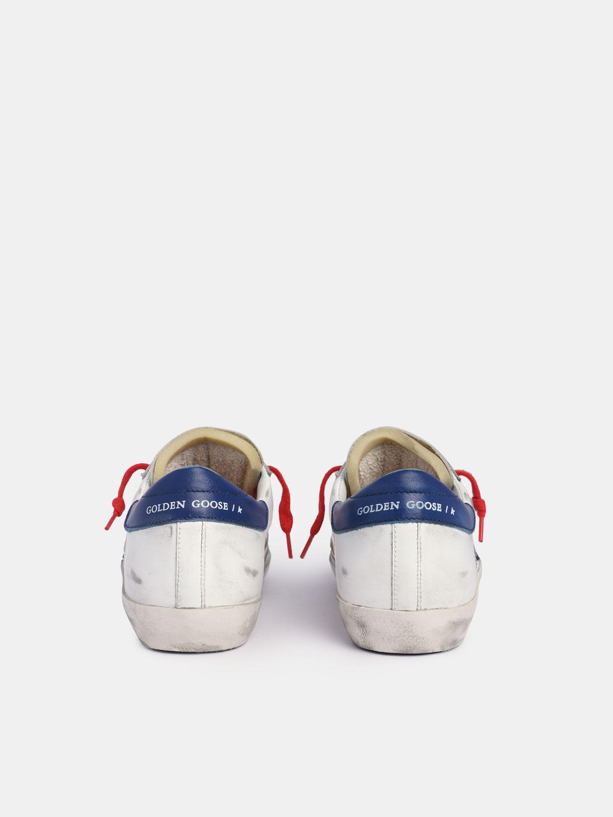 Super-Star sneakers in white leather with black star and blue heel tab 4