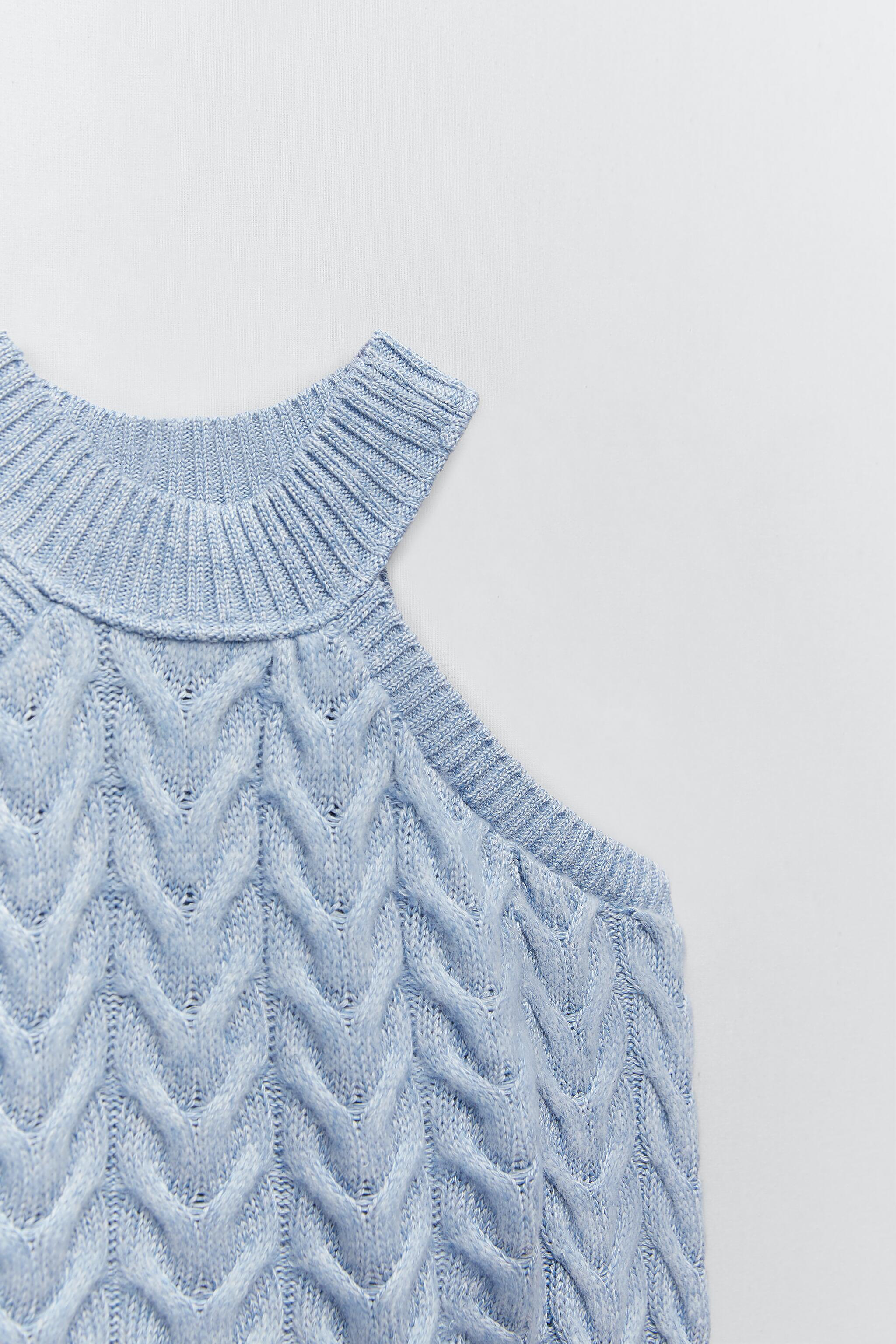 CUT OUT CABLE-KNIT TOP 4