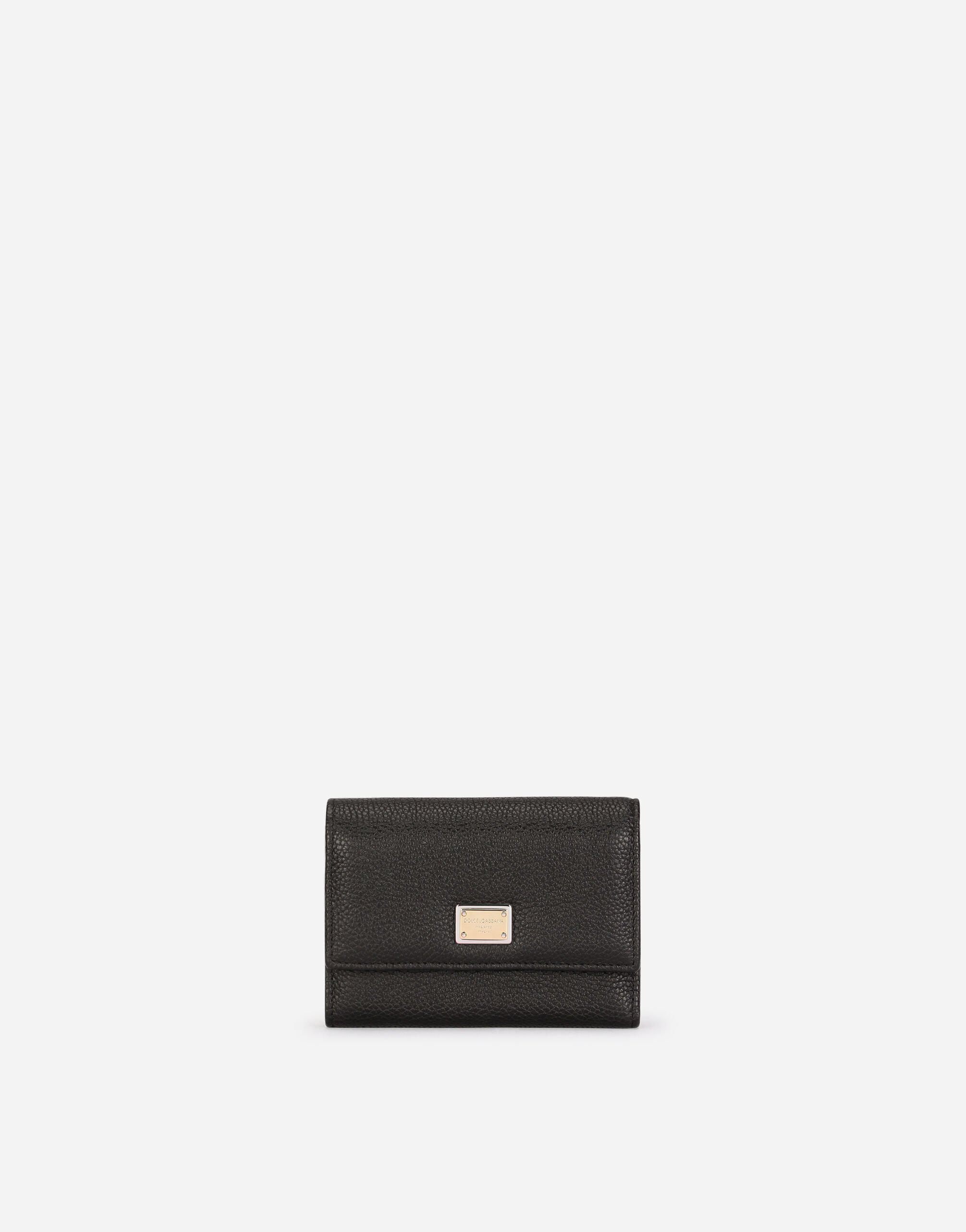 Small continental wallet in tumbled calfskin with branded tag