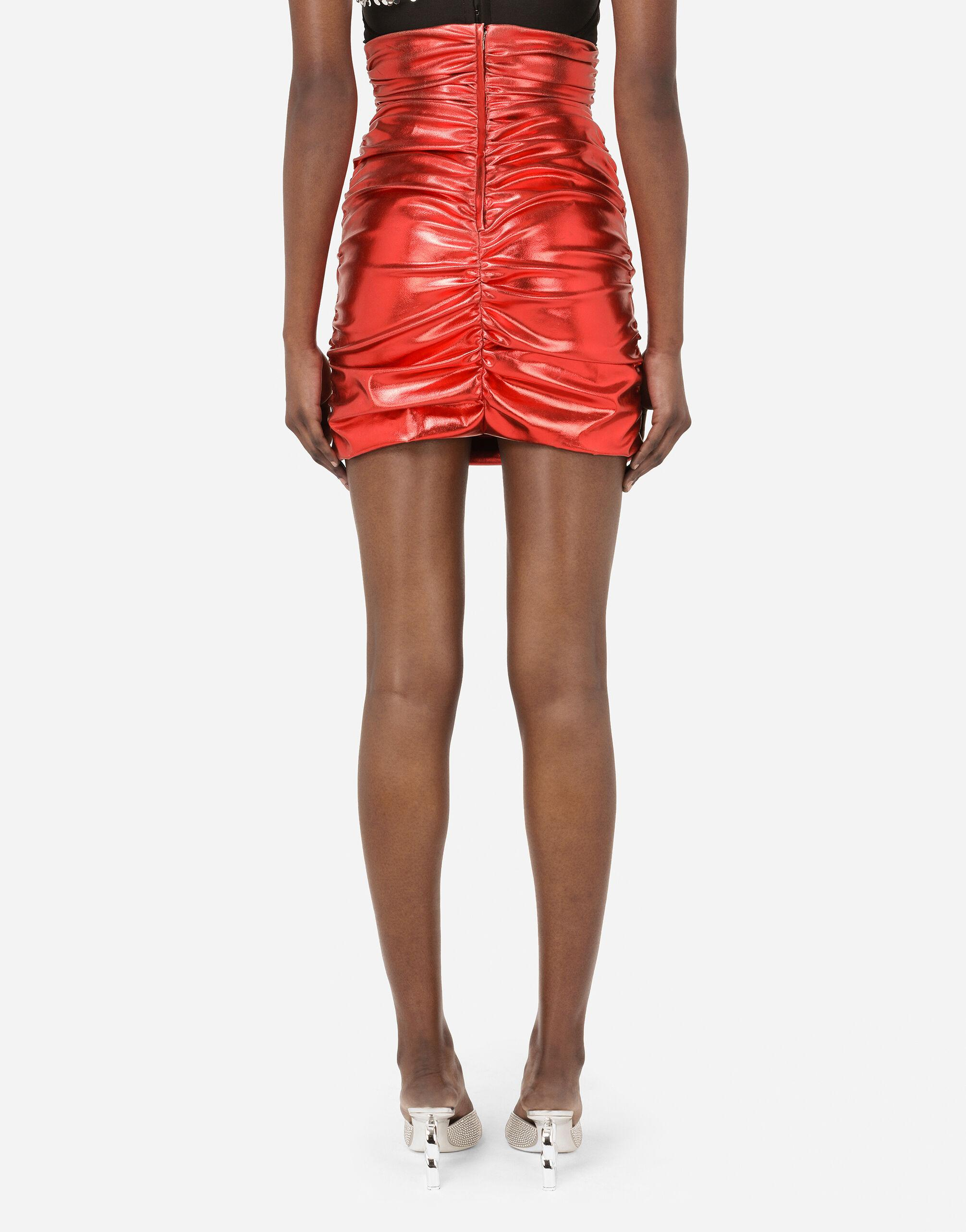 Foiled fabric miniskirt with draping 1