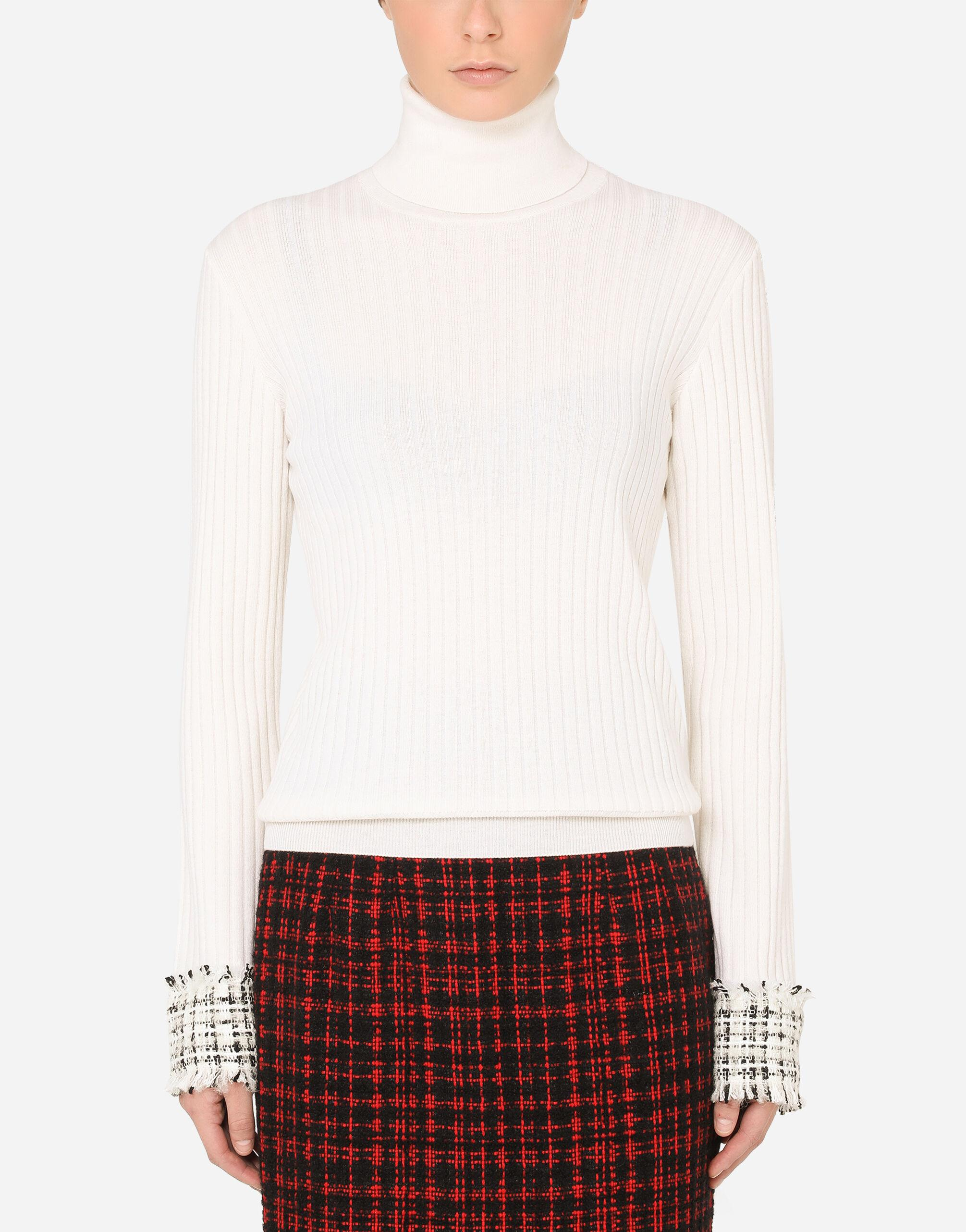Wool turtle-neck sweater with tweed cuffs