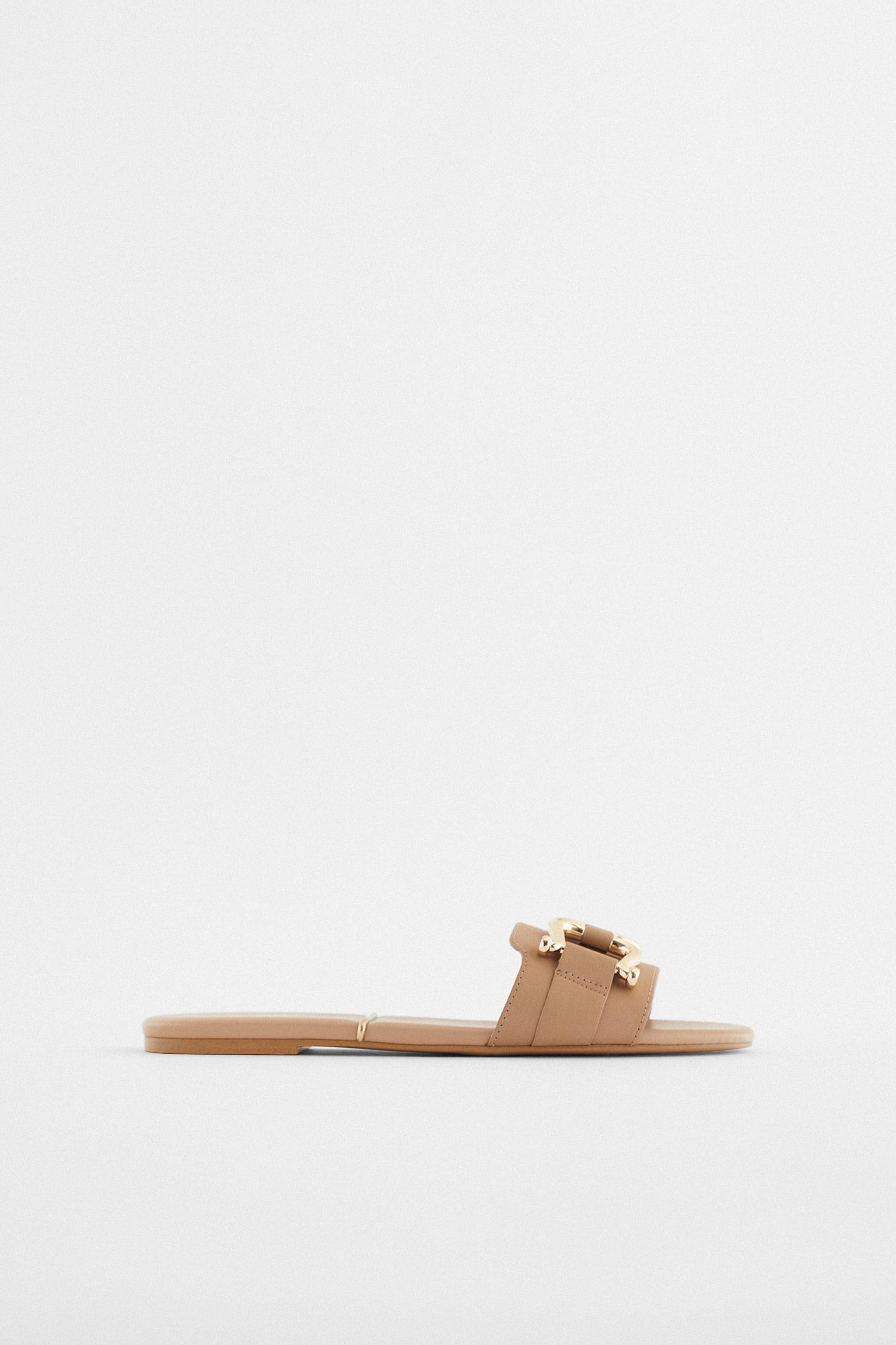 FLAT LEATHER SANDALS WITH GOLD SADDLE DETAIL 0