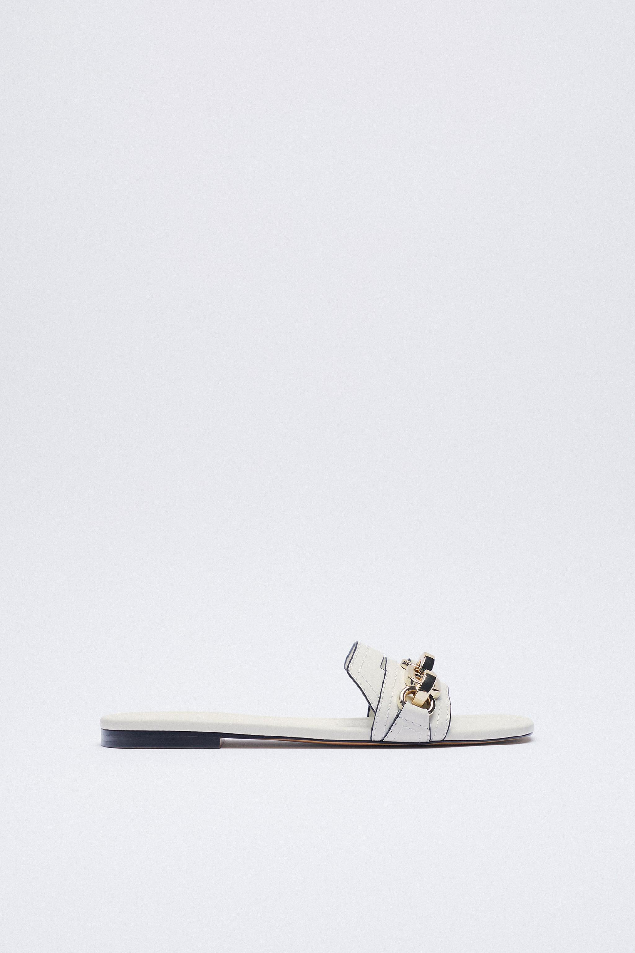 FLAT LEATHER SANDAL WITH BUCKLE