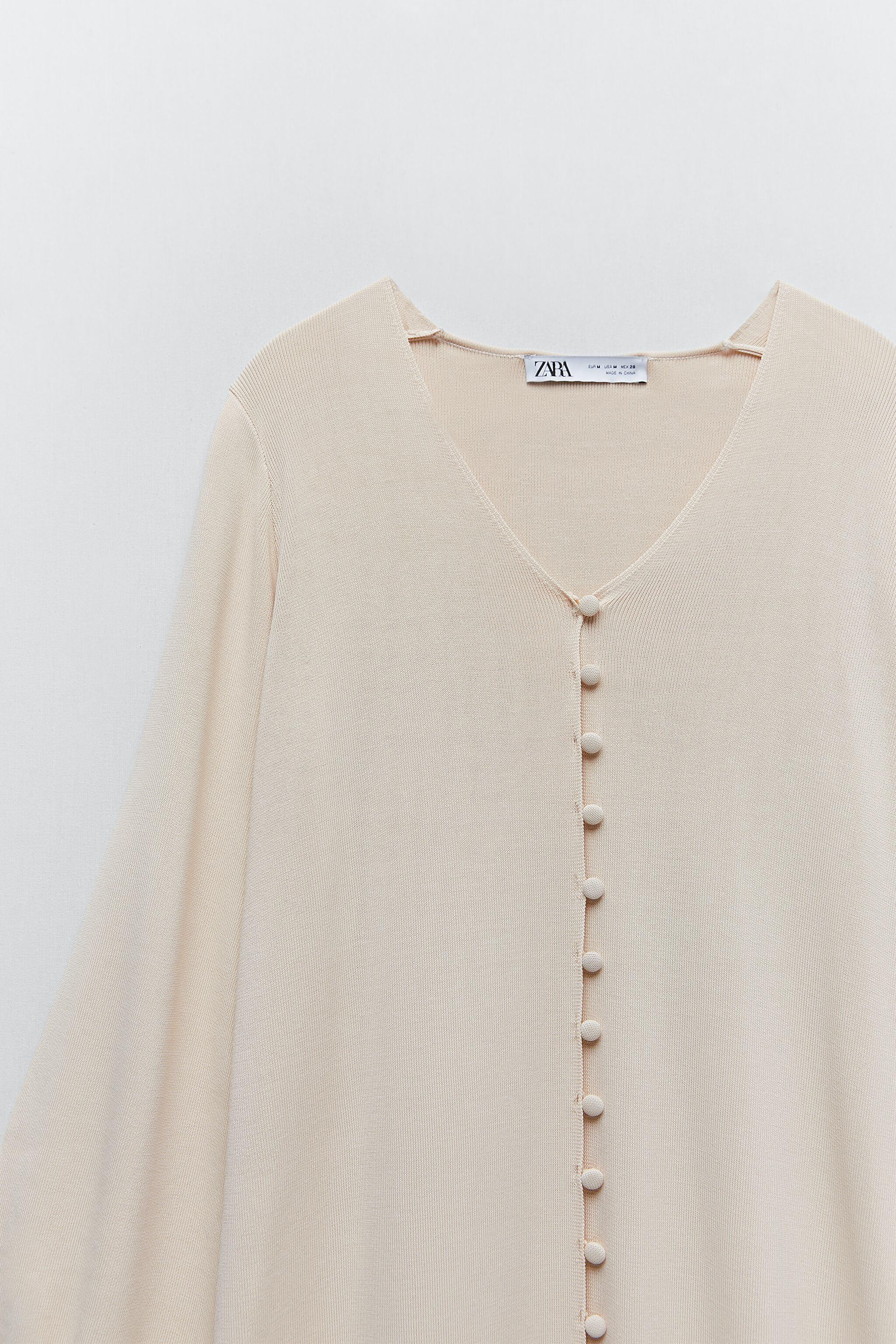 LIMITED EDITION BUTTONED KNIT DRESS 10