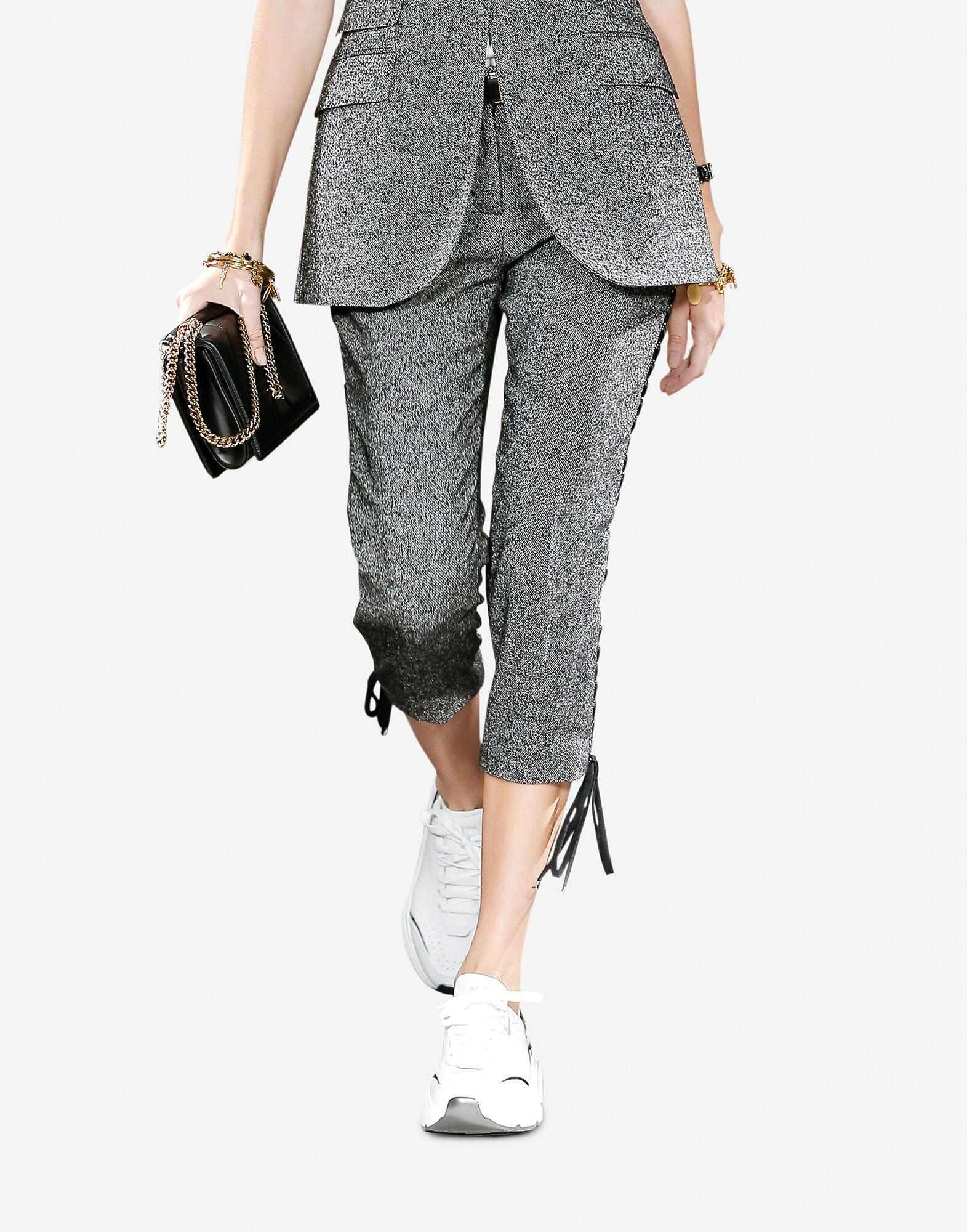 Micro-patterned wool pants with eyelet details