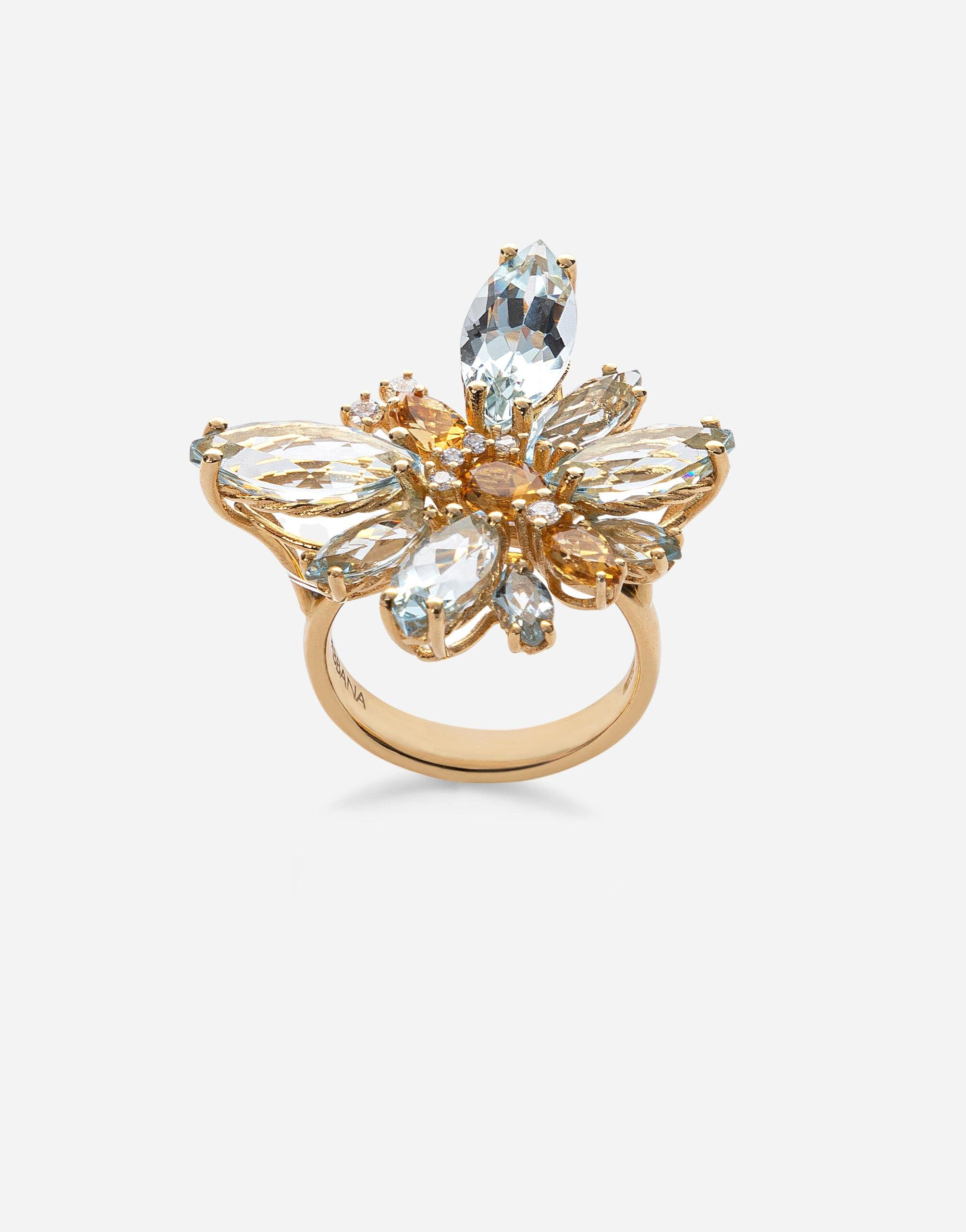 Spring ring in yellow 18kt gold with aquamarine butterfly