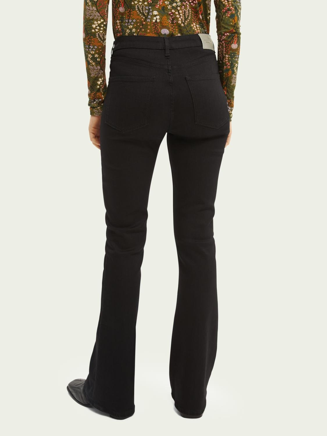The Charm high-rise flared jeans —Think Different 2