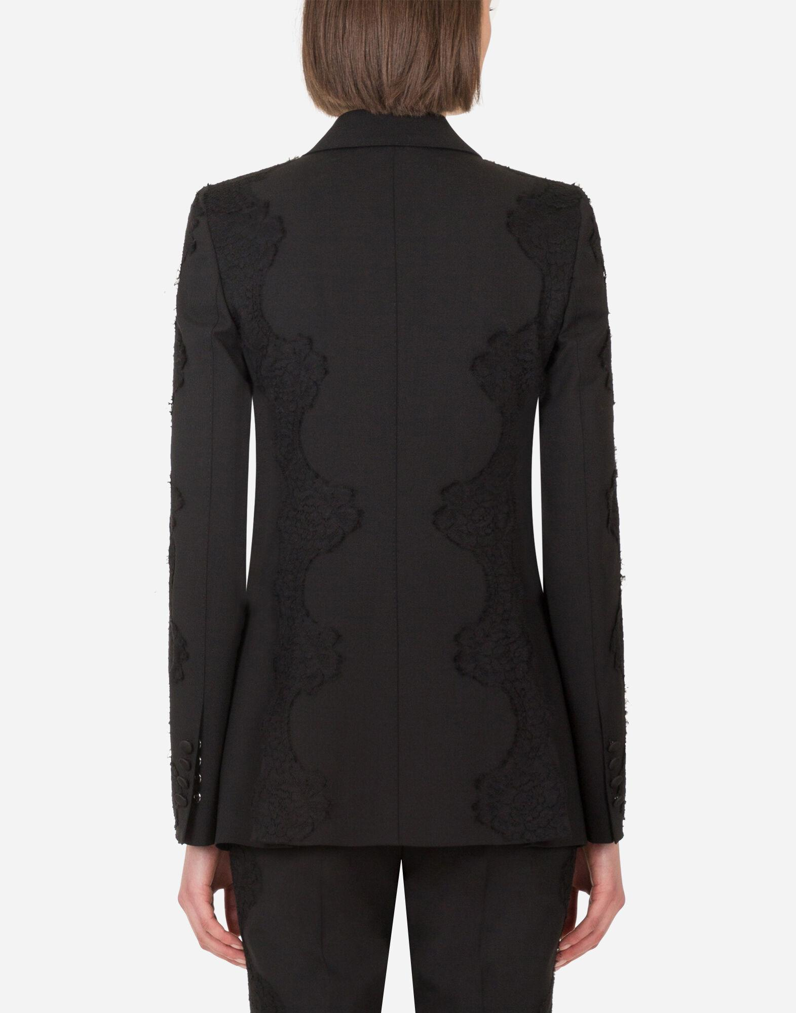 Single-breasted woolen blazer with lace details 1