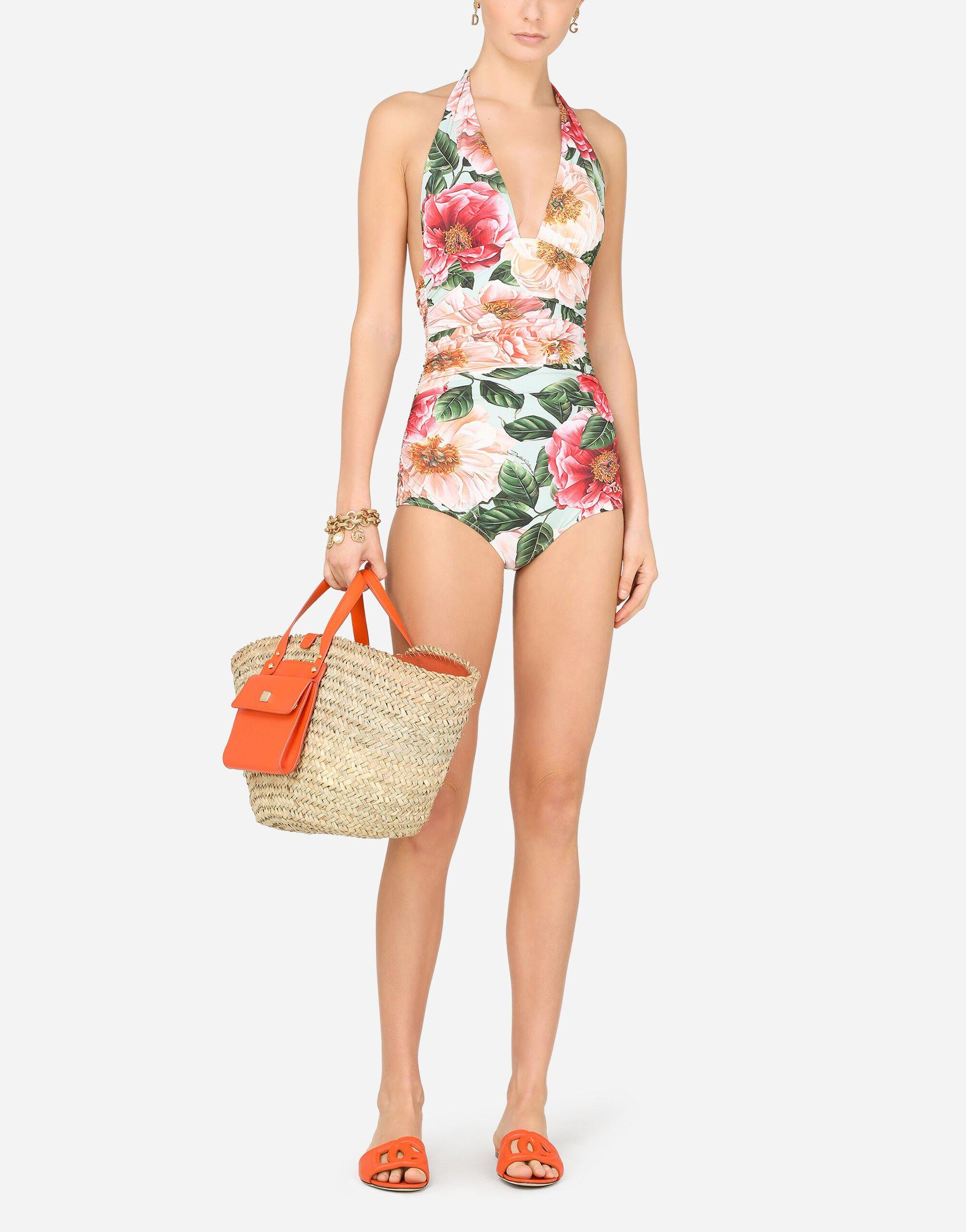 Camellia-print one-piece swimsuit with plunging neckline