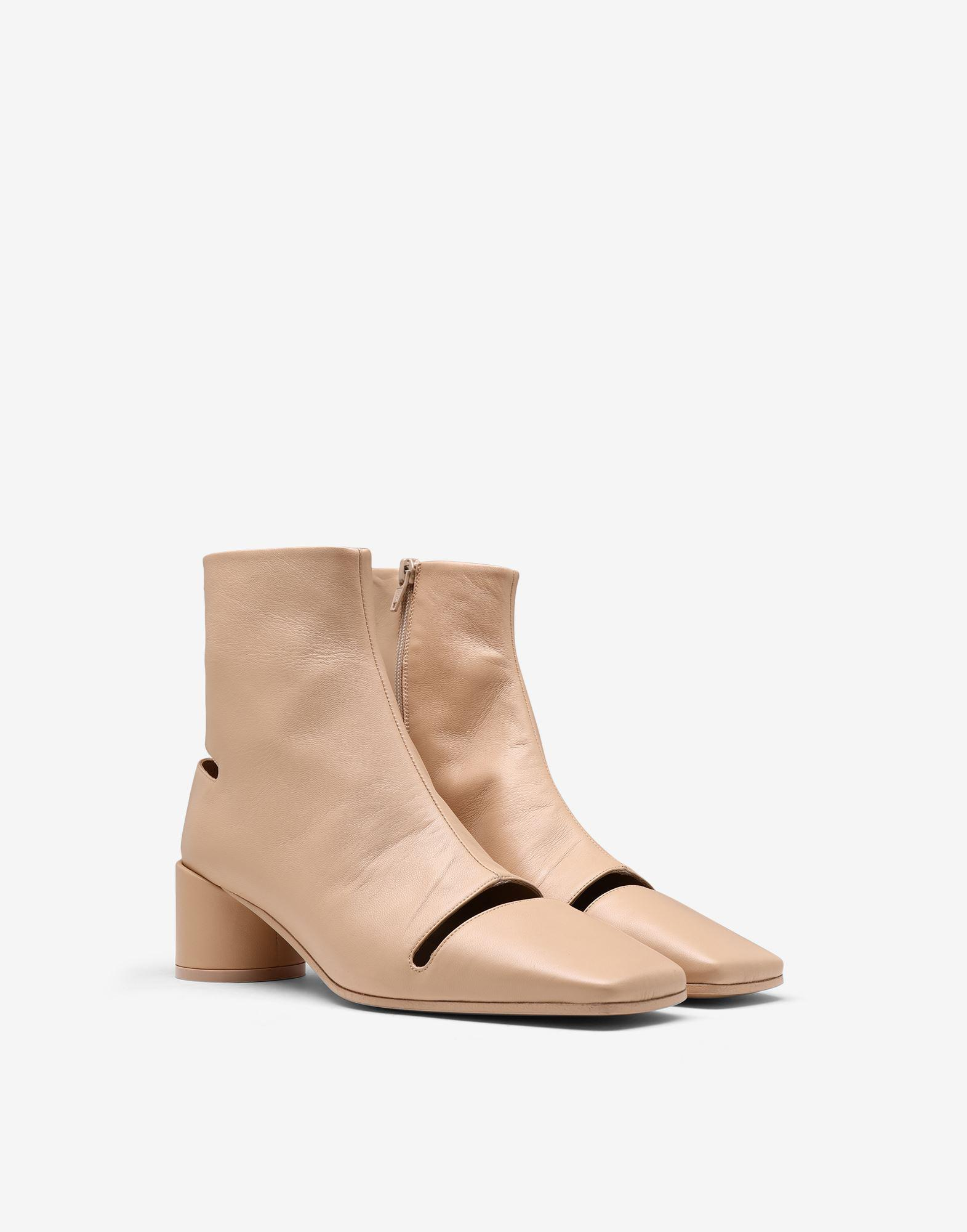 Cut-out leather ankle boots 1