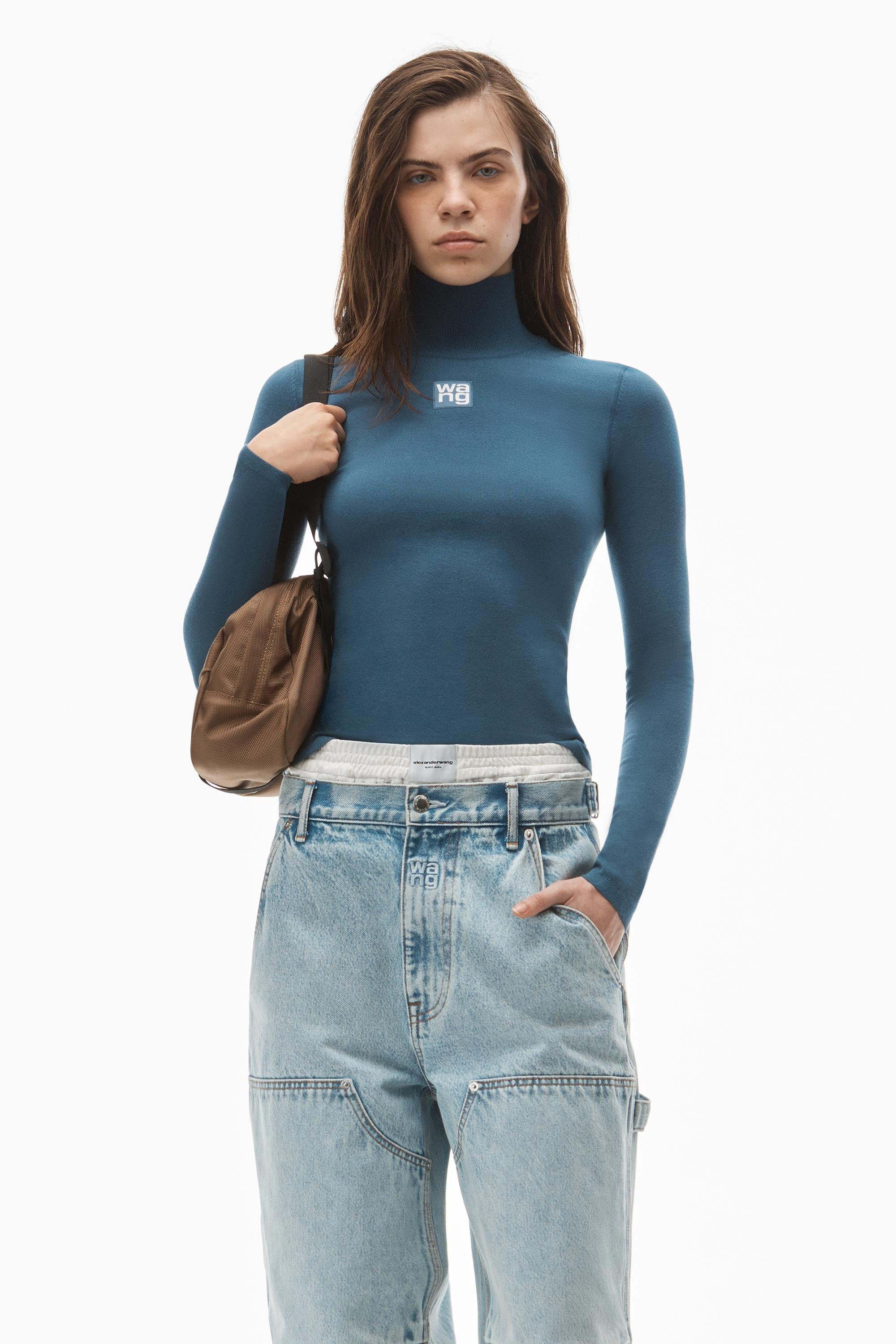 logo patch turtleneck top in bodycon knit