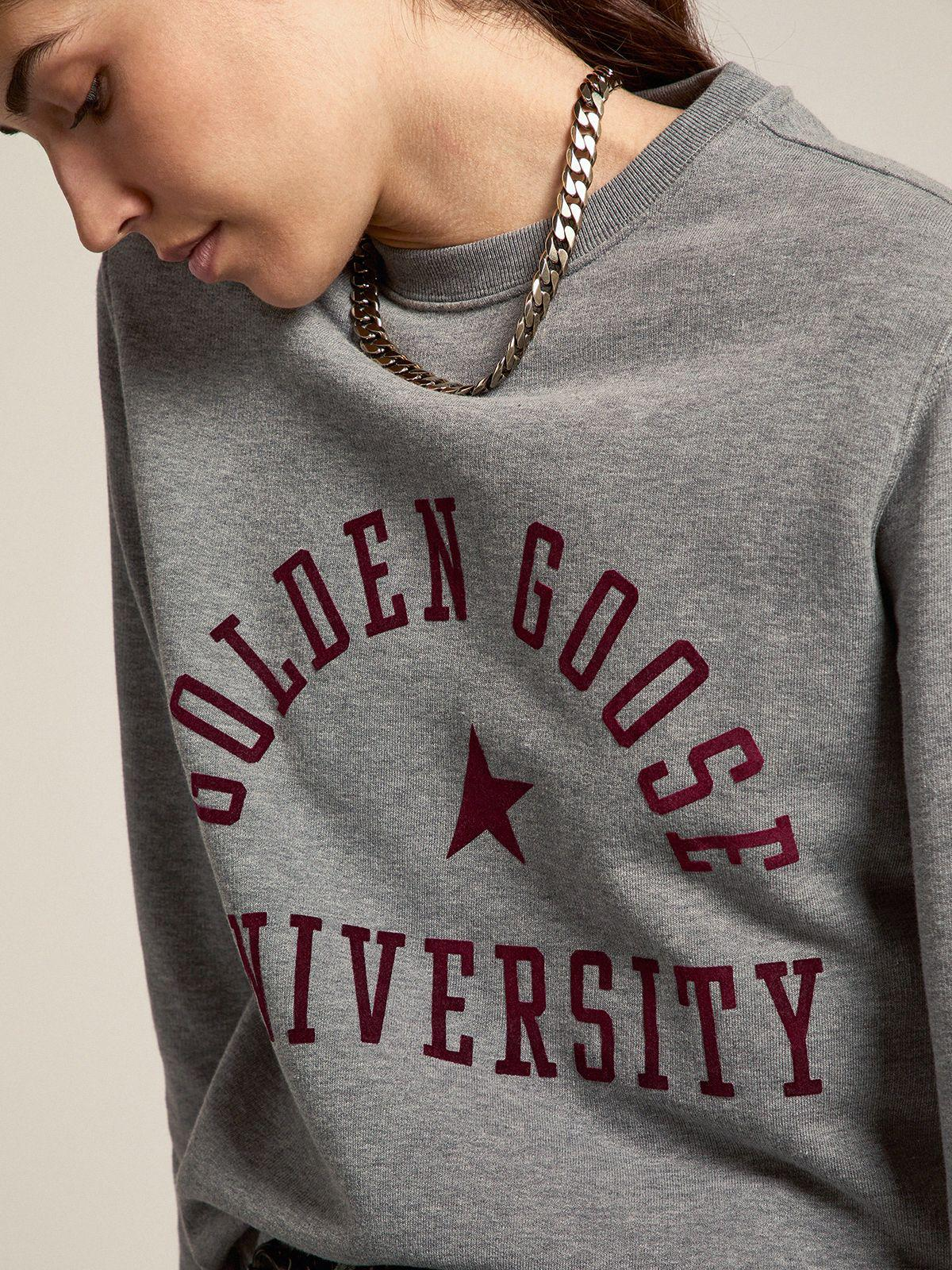 Gray melange Journey Collection Athena sweatshirt with maroon logo on the front 3