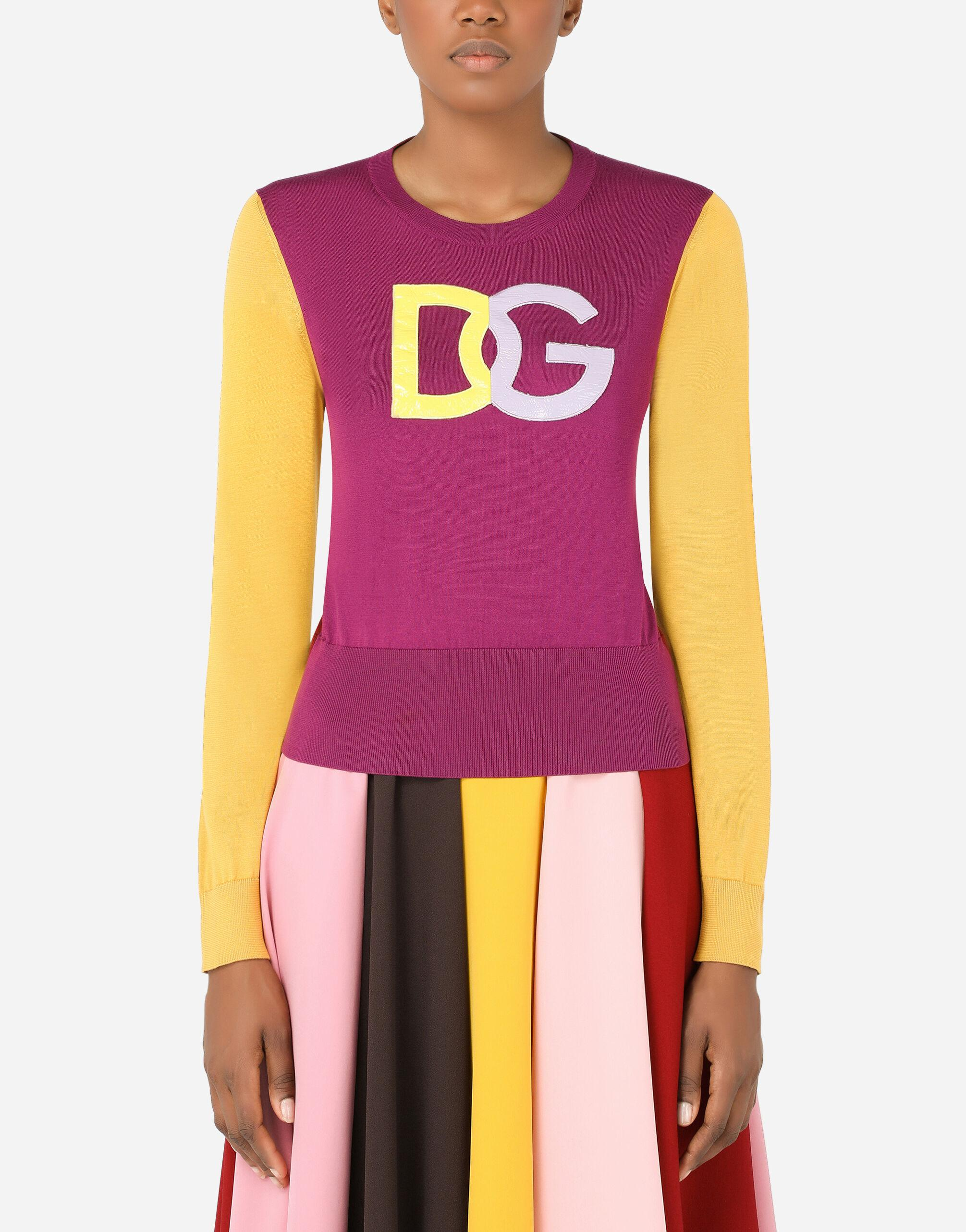 Multi-colored silk sweater with patent leather DG patch