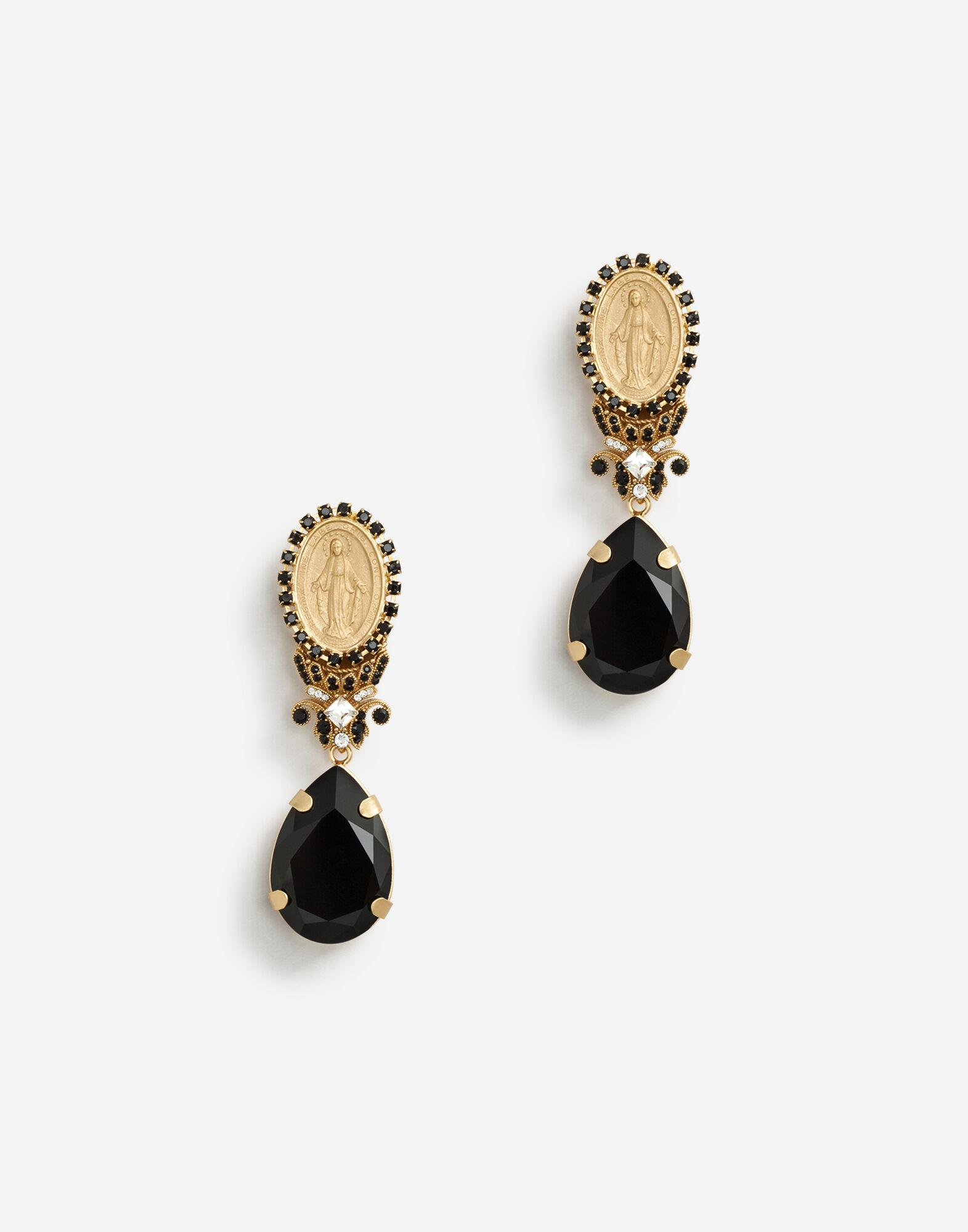 Pendant earrings with votive decorations and rhinestones