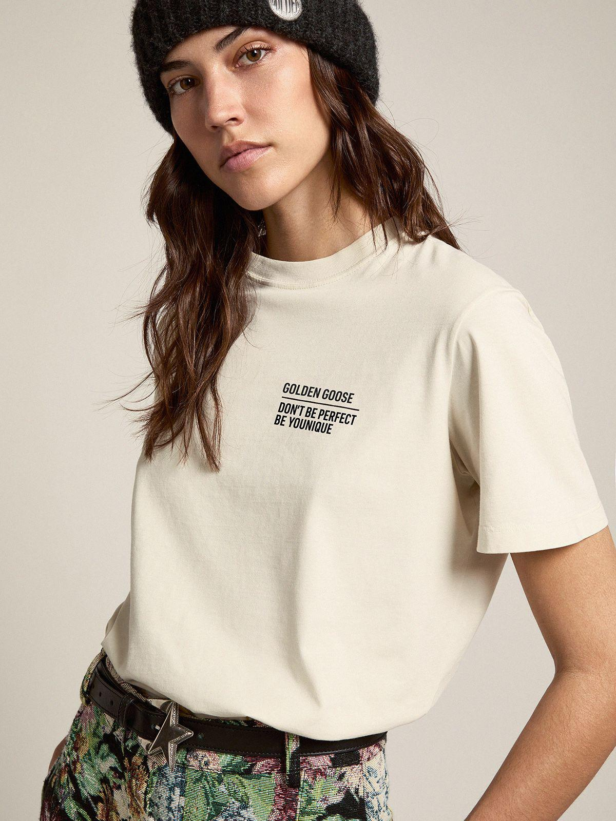 Bone white Journey Collection T-shirt with contrasting black logo and lettering on the front