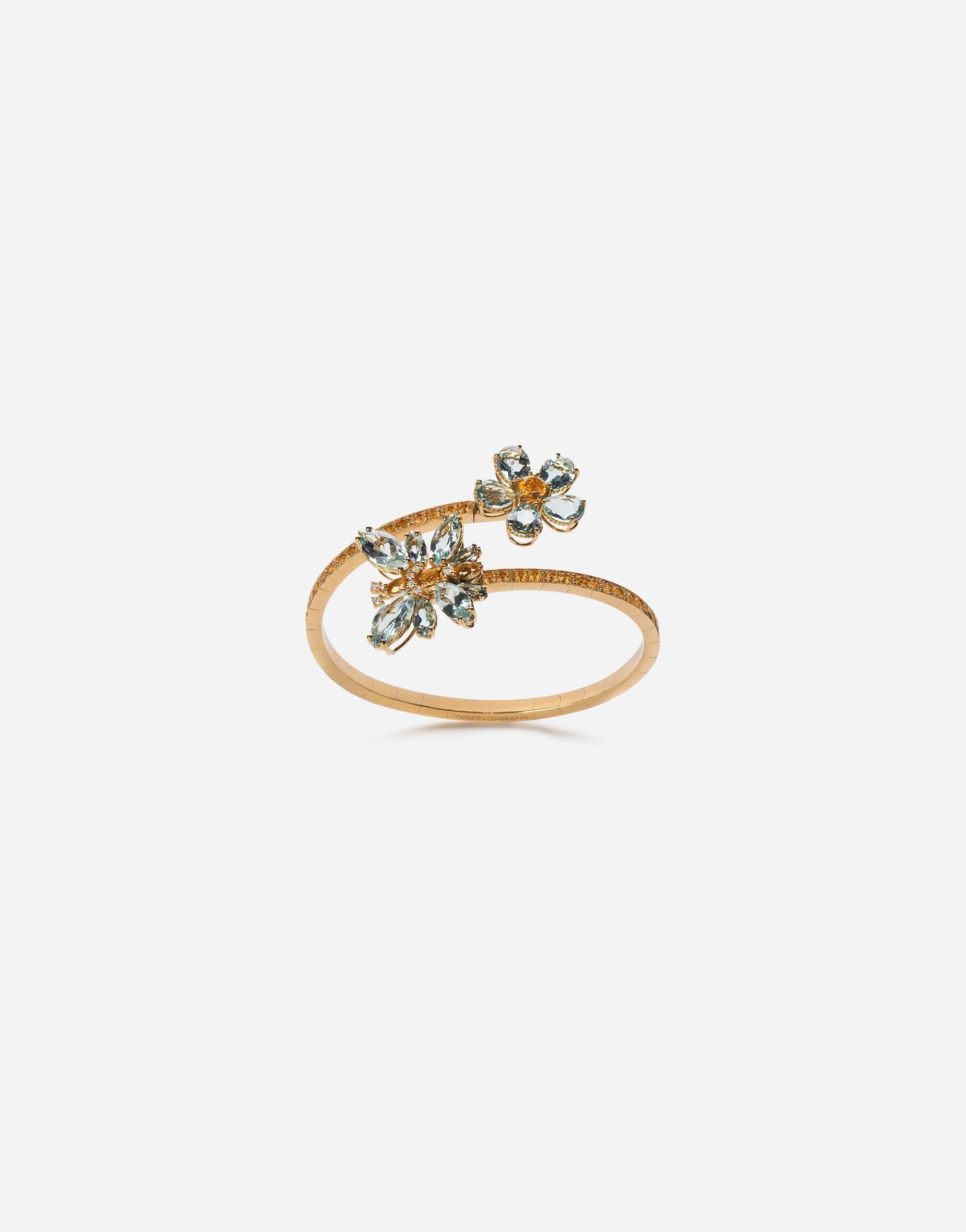 Spring yellow gold bracelet with butterfly-shaped settings and floral decoration