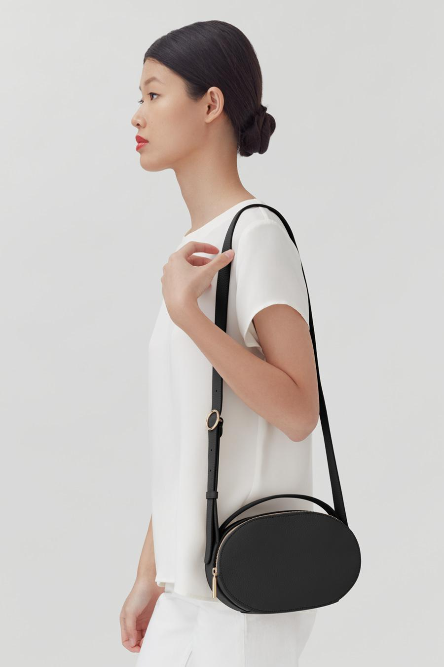 Women's Top Handle Crossbody Bag in Black   Pebbled Leather by Cuyana 4