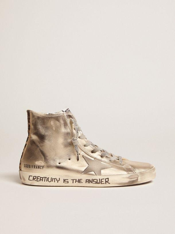 Gold Francy sneakers with handwritten lettering and leopard-print detail