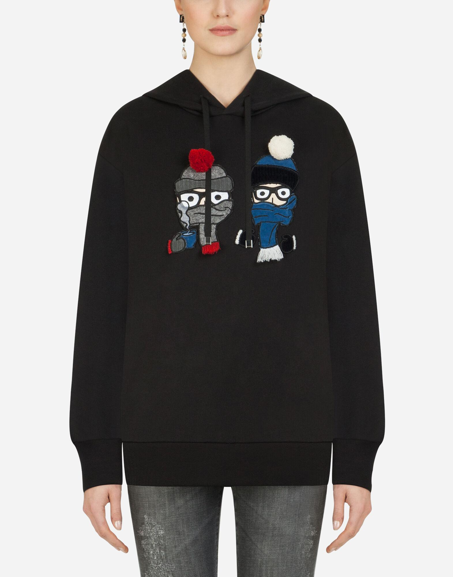 Hoodie with patches of the designers