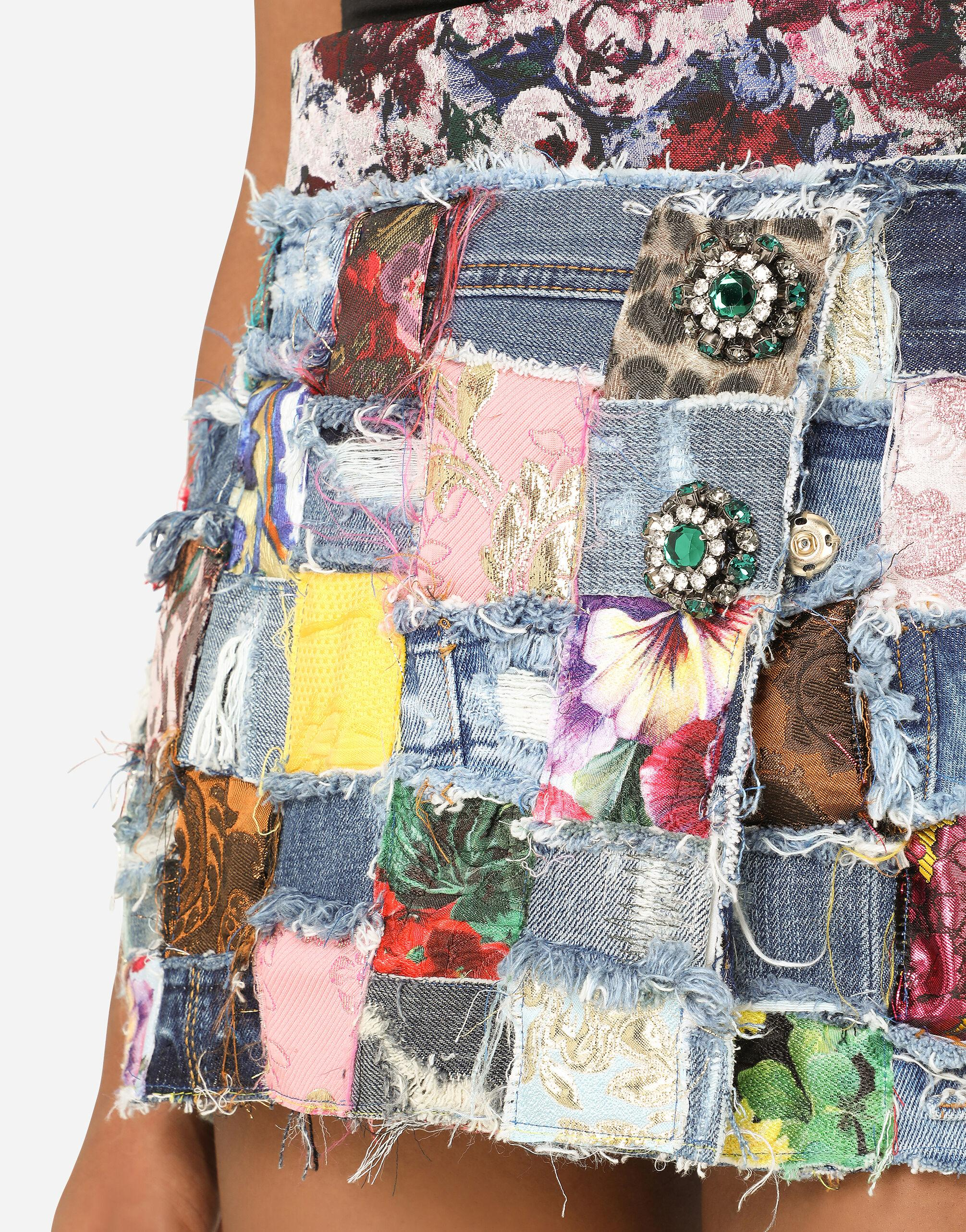 Denim miniskirt with interwoven patchwork detailing and bejeweled buttons 5