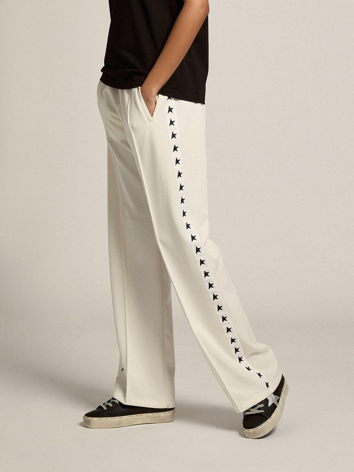 Papyrus white Dorotea Star Collection jogging pants with black stars on the sides