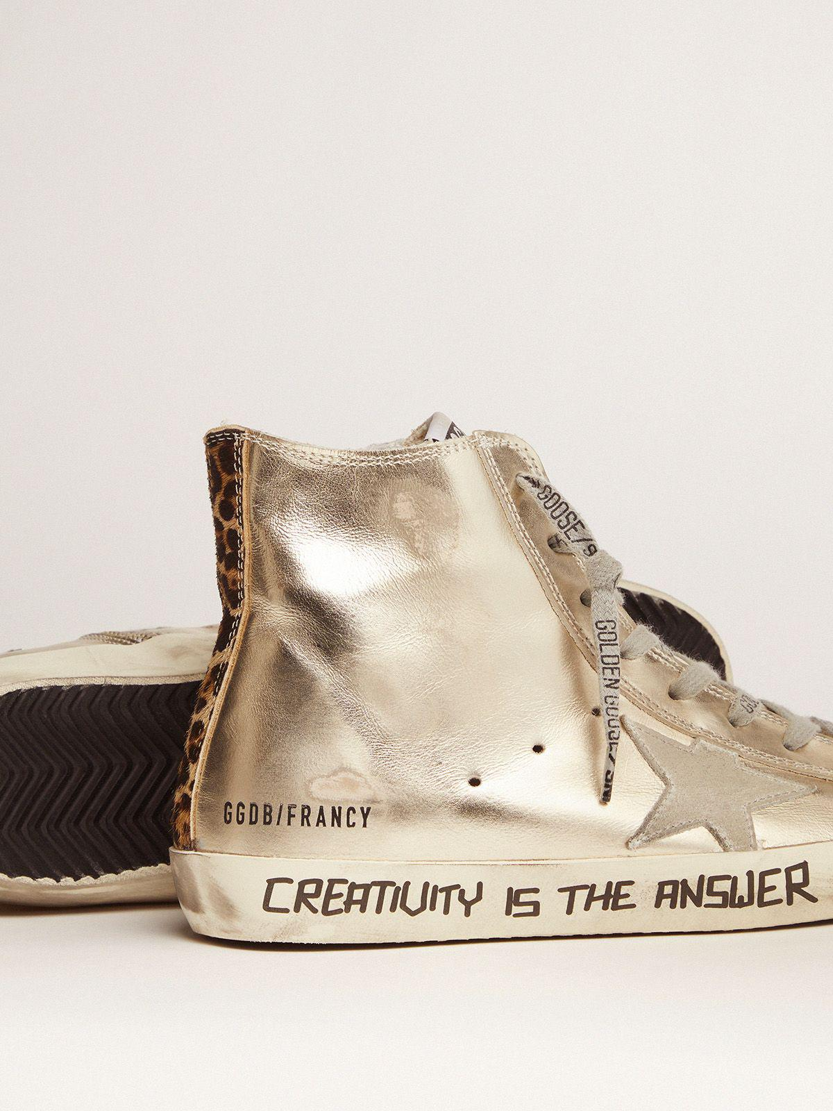 Gold Francy sneakers with handwritten lettering and leopard-print detail 2
