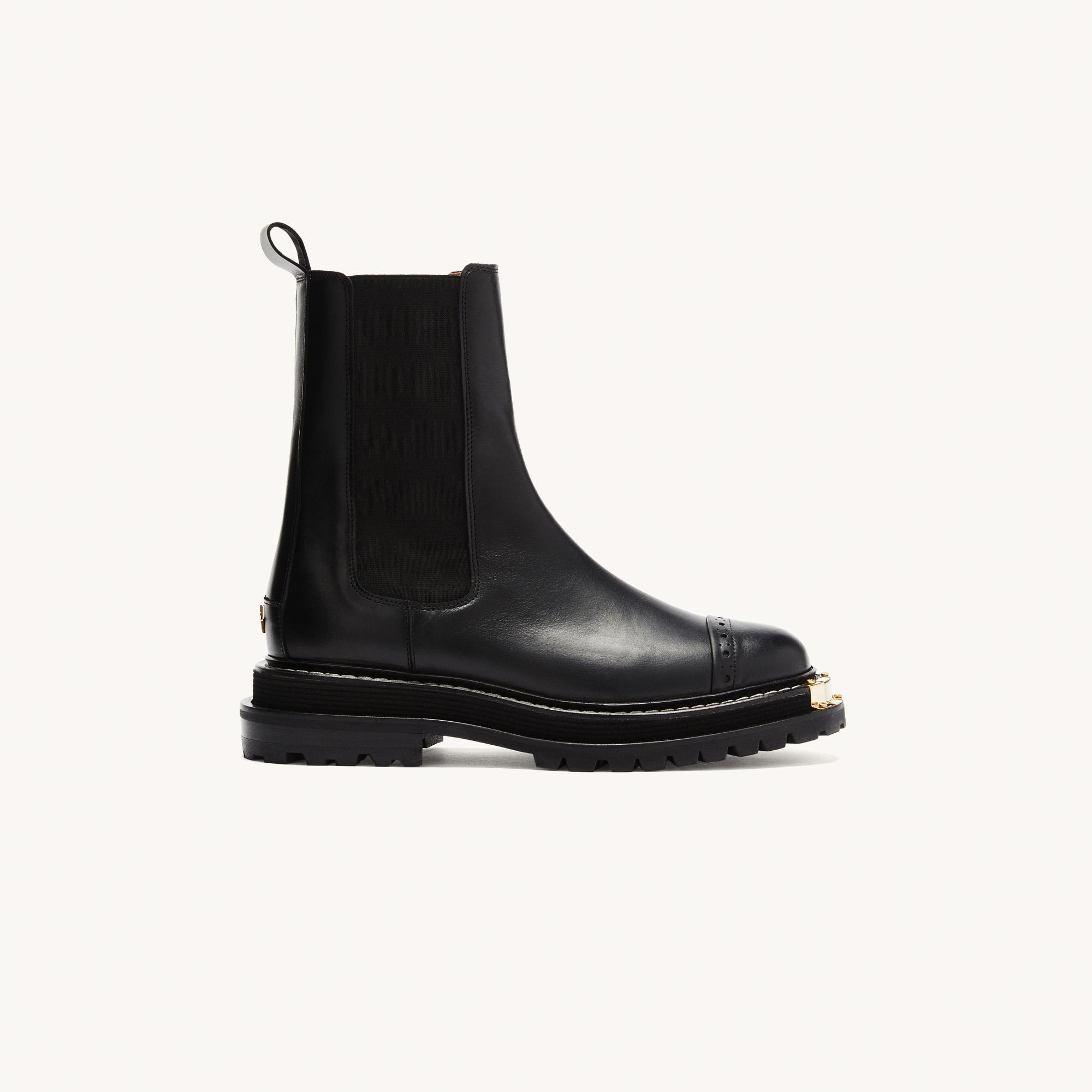 Ankle boots with notched sole