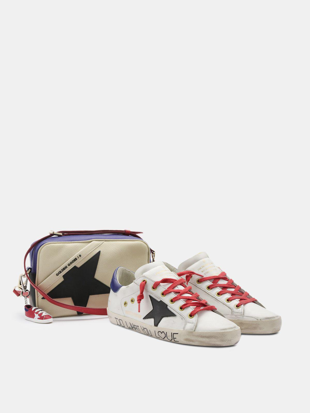 Super-Star sneakers in white leather with black star and blue heel tab 1