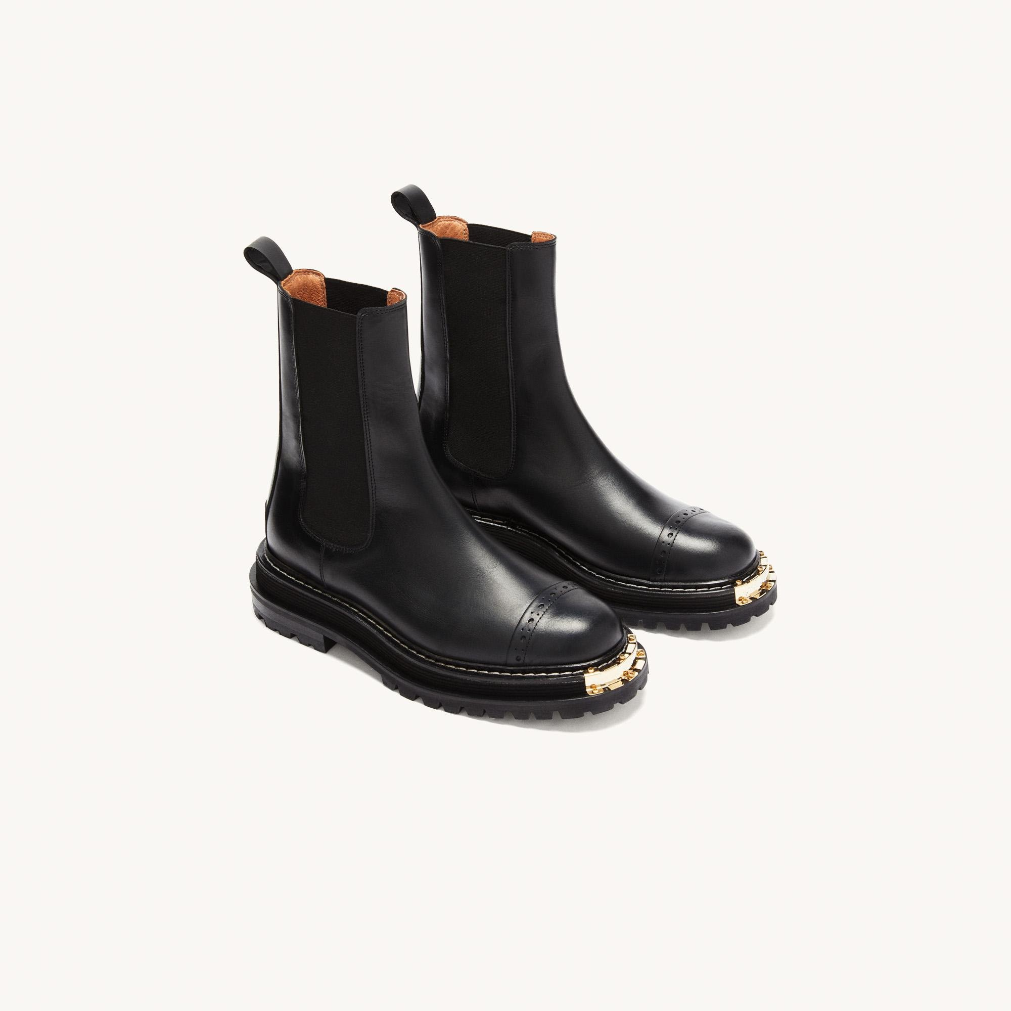 Ankle boots with notched sole 1