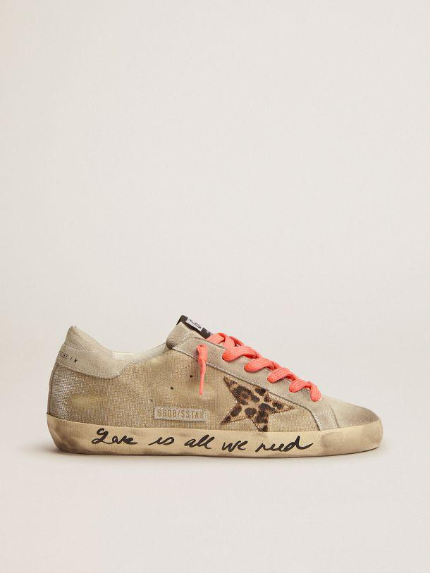 Golden Super-Star sneakers with checkered pattern and hand lettering on the foxing