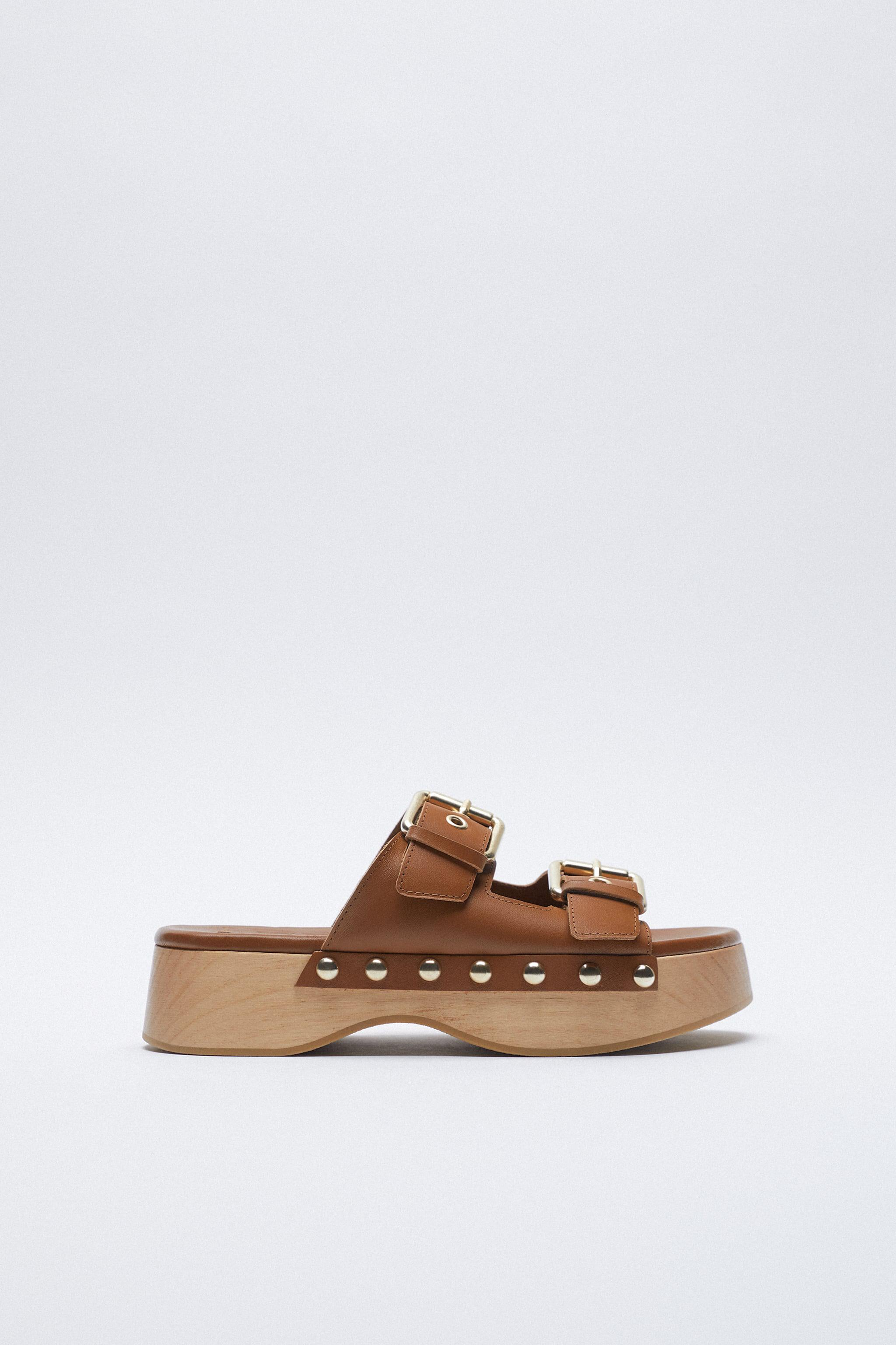 BUCKLED LEATHER CLOGS