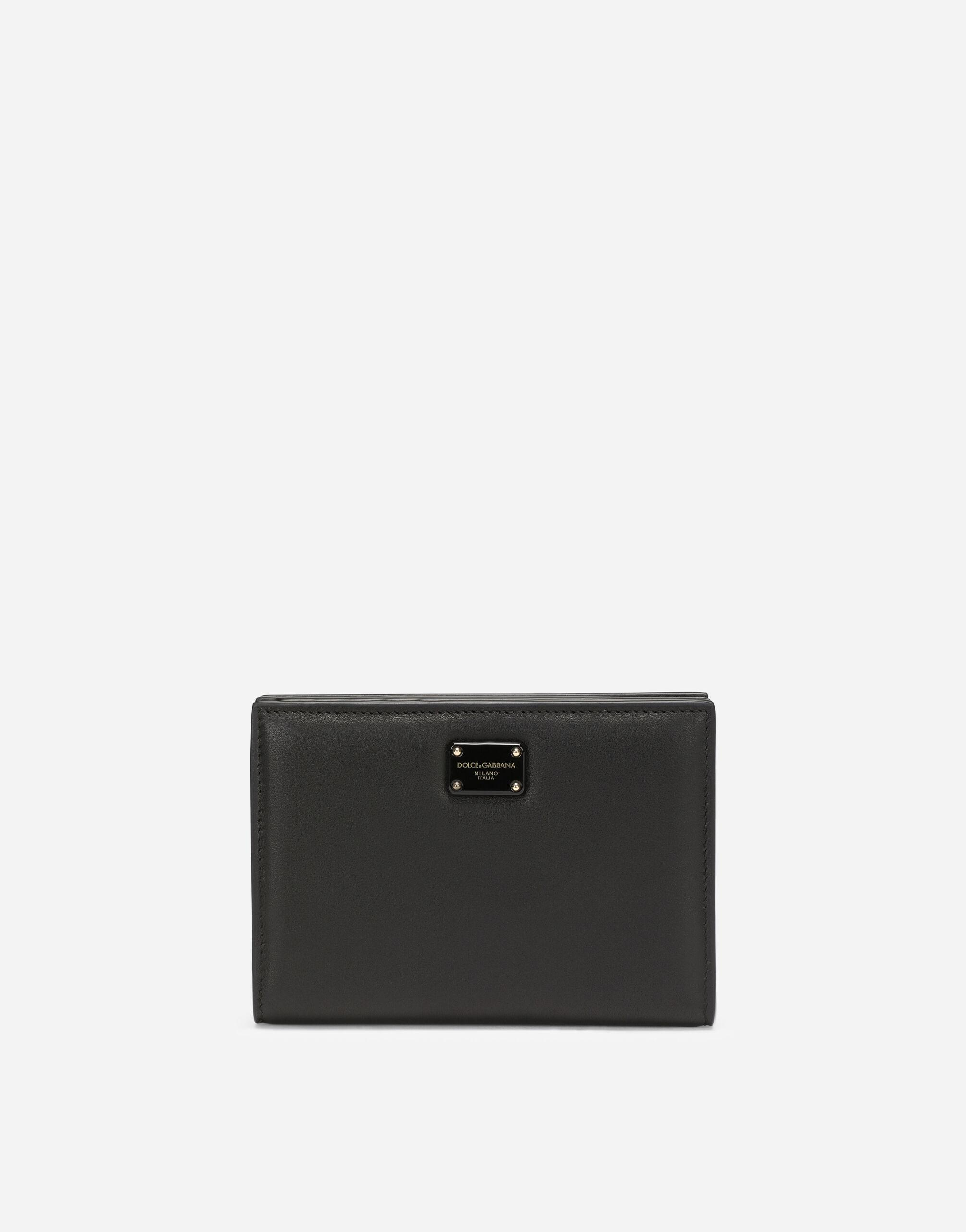 Small calfskin wallet with branded plate