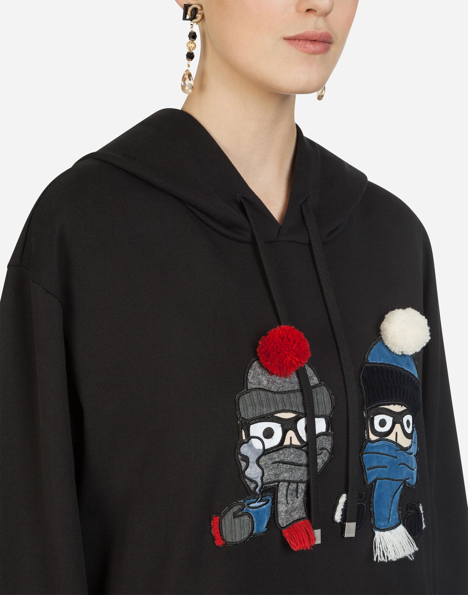 Hoodie with patches of the designers 2